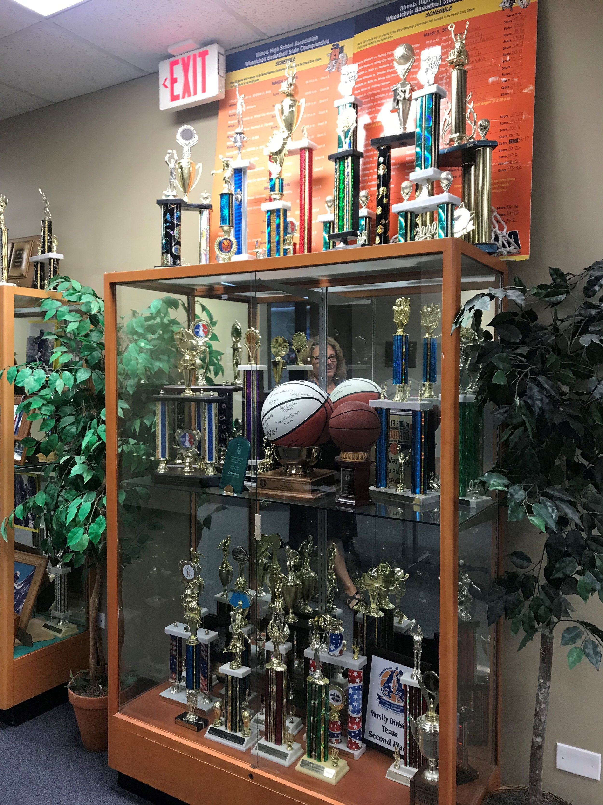 A trophy case at the WDSRA office illustrates the success of its athletic programs
