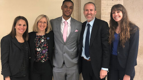 Eric Blackmon (center) with his lawyers from the Northwestern University Center on Wrongful Convictions. (photo courtesy of COD Newsroom)