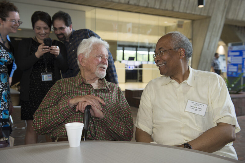 Former Fermilab Director Leon Lederman (left) chatting with Senior Scientist Dr. Herman V. White at Wilson Hall