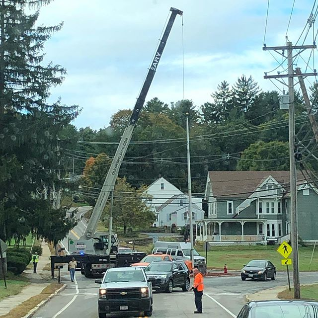Major emergency operation on Rt 16 this morning to pull down a flagpole hit by a car before it fell. Only a few wires to contend with! #emergencyoperation #construction #flagpole #carcrash #motorvehiclecrash #emergencyremoval #crane #nationalcrane #douglas #douglasma #douglasmassachusetts #olearycraneservice #olearywelding