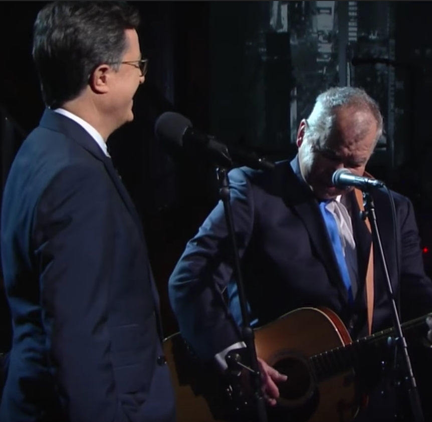 "Watch Colbert & Prine do ""That's The Way The World Goes Round'"