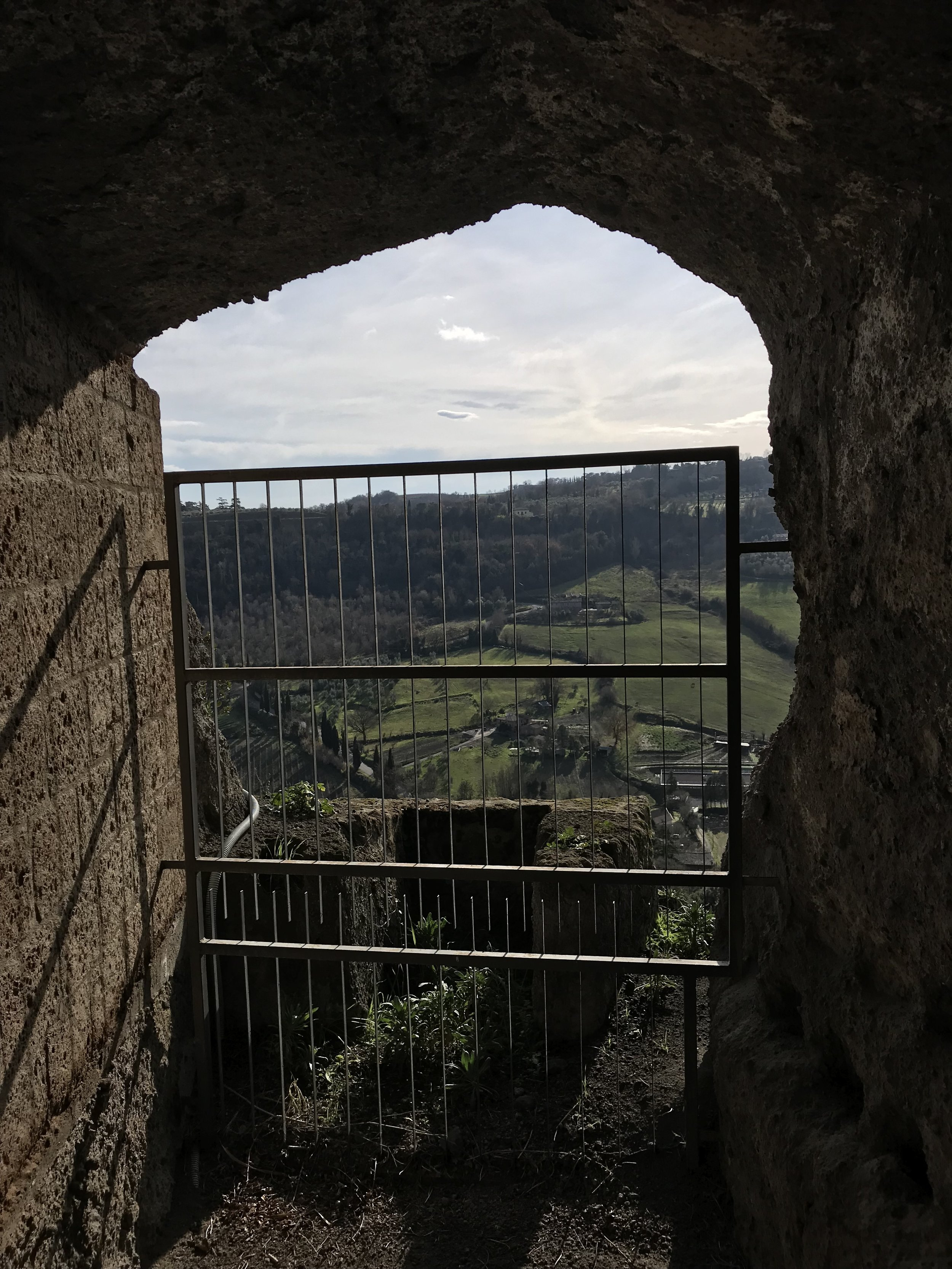 The view out from one of the caves on the edge of the raised plateau. There are also a few restaurants and wine bars in Orvieto's underground.