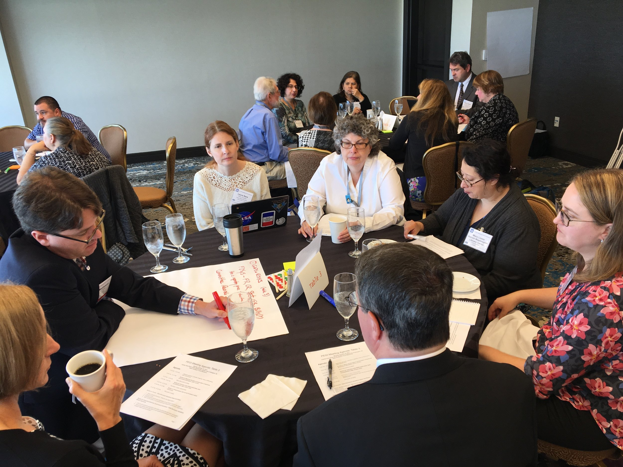 The group at table 3 identifying issues with preservation of electronic government information.
