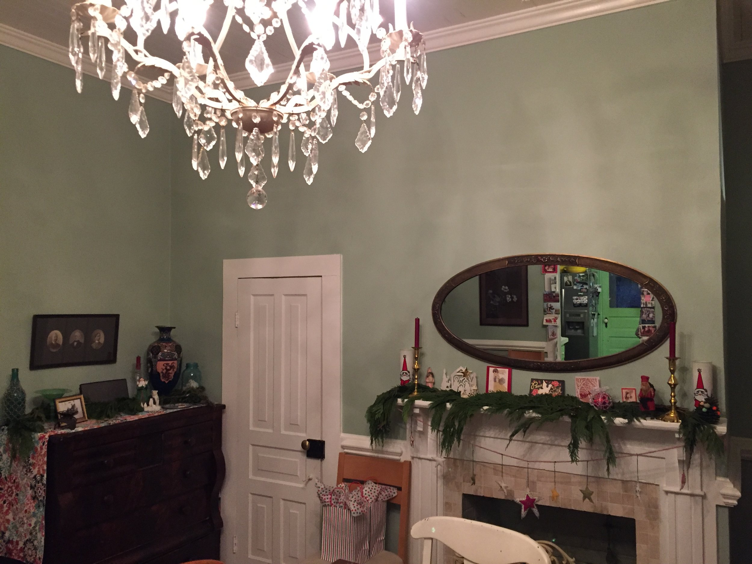 My beautiful dining room at Christmas time. The new hallway door will be where the black and white picture of my grandfathers are in this picture. The precious little coat closet will stay, because, why not?