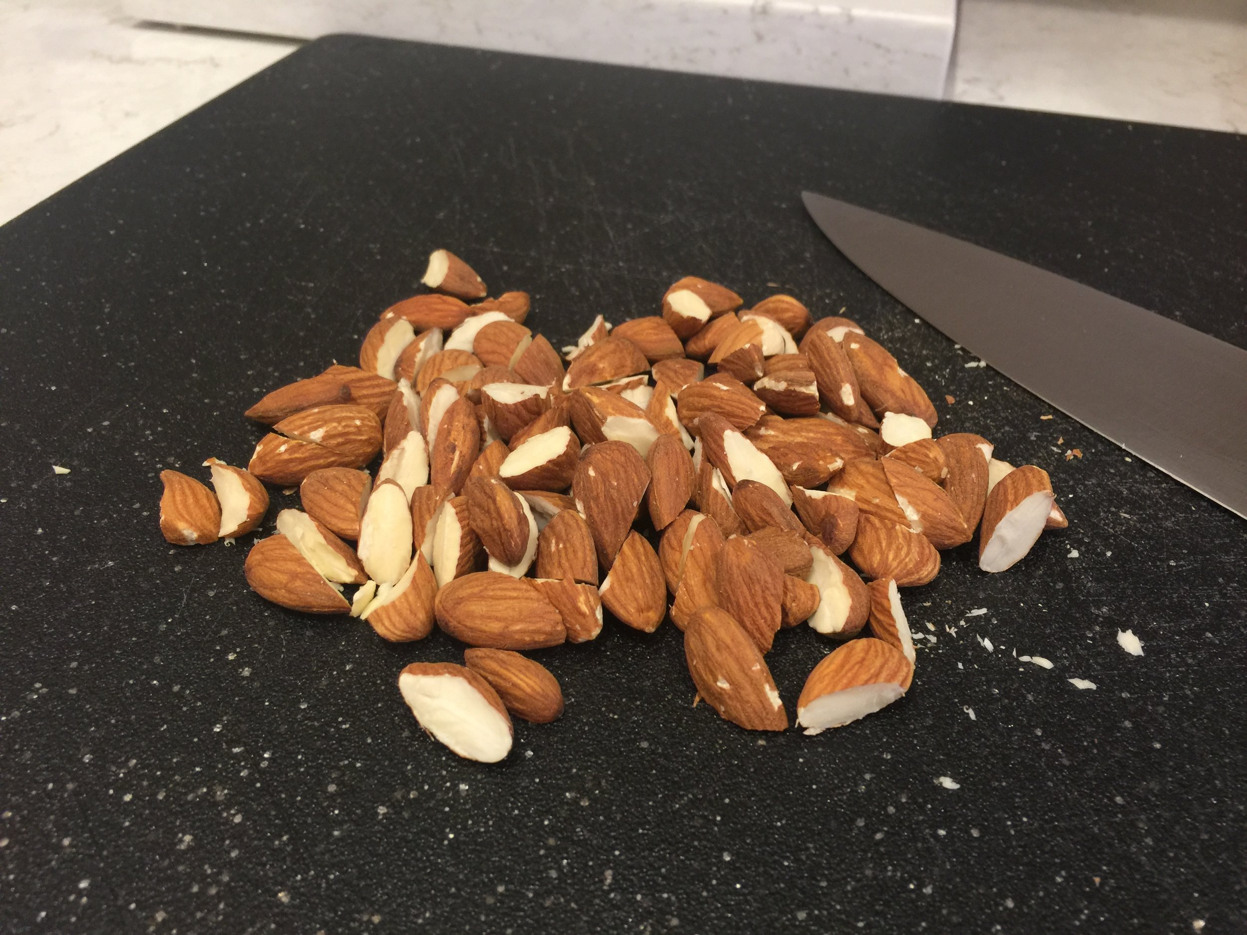 I cut my almonds in half, thinking it would help the bars stay together better. I think it did.