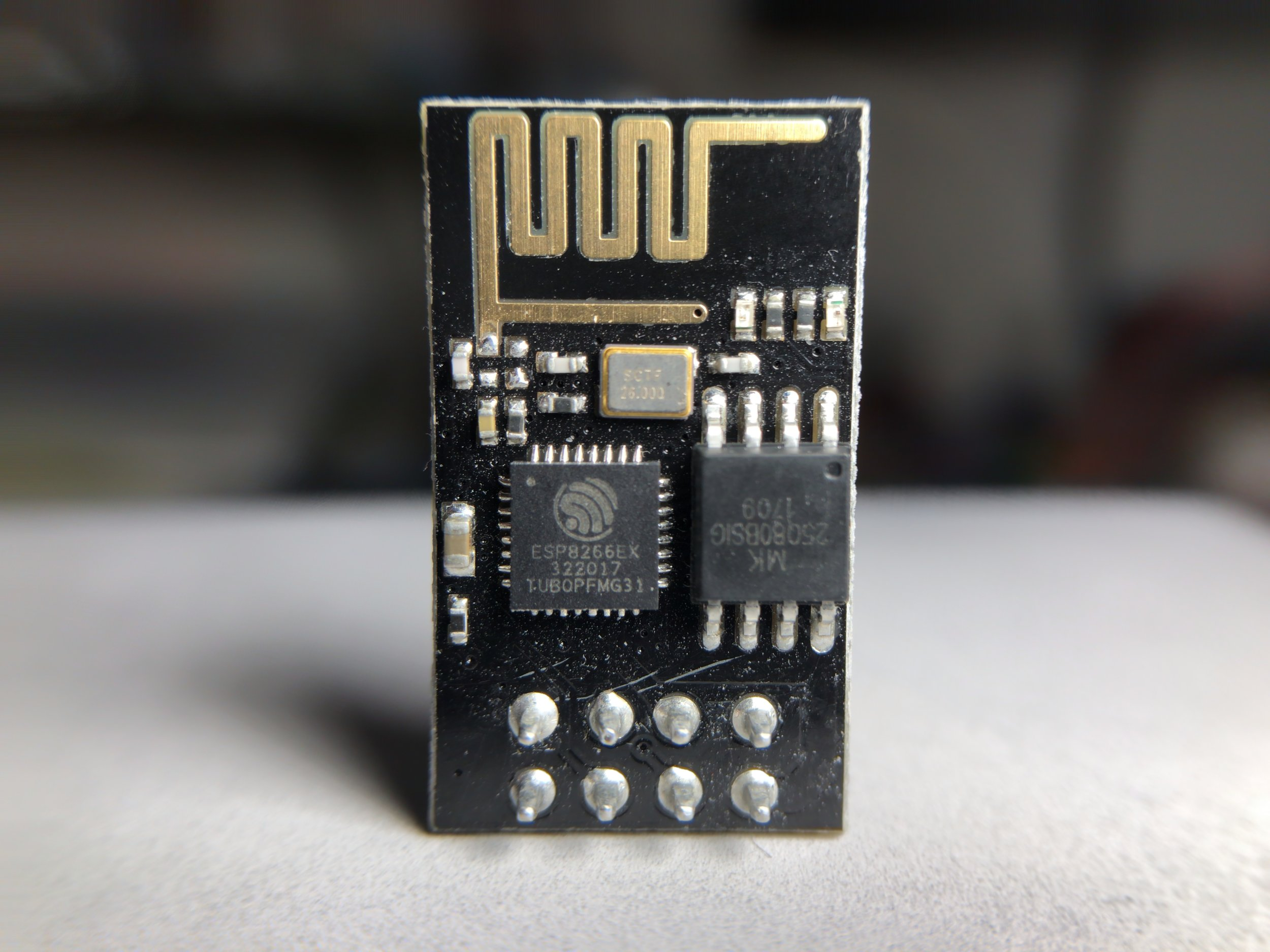 Figure 1:  ESP8266 module with 8 breakout pins. This module is just over $3 when bought in a 4-pack, and even cheaper at times.