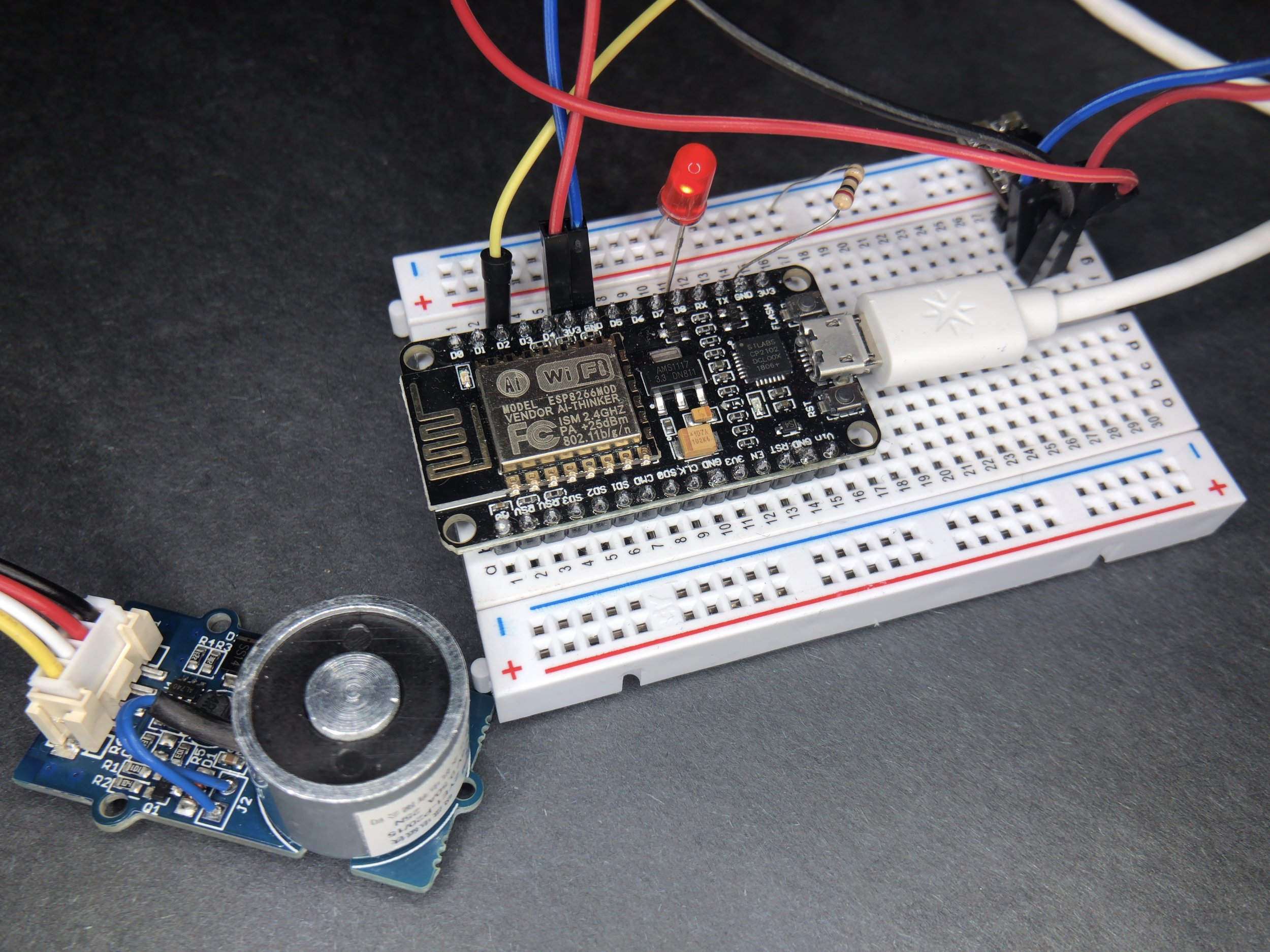 Setup showing electromagnet, NodeMCU, and LED used in this tutorial for server-side control of the NodeMCU Arduino WiFi board.