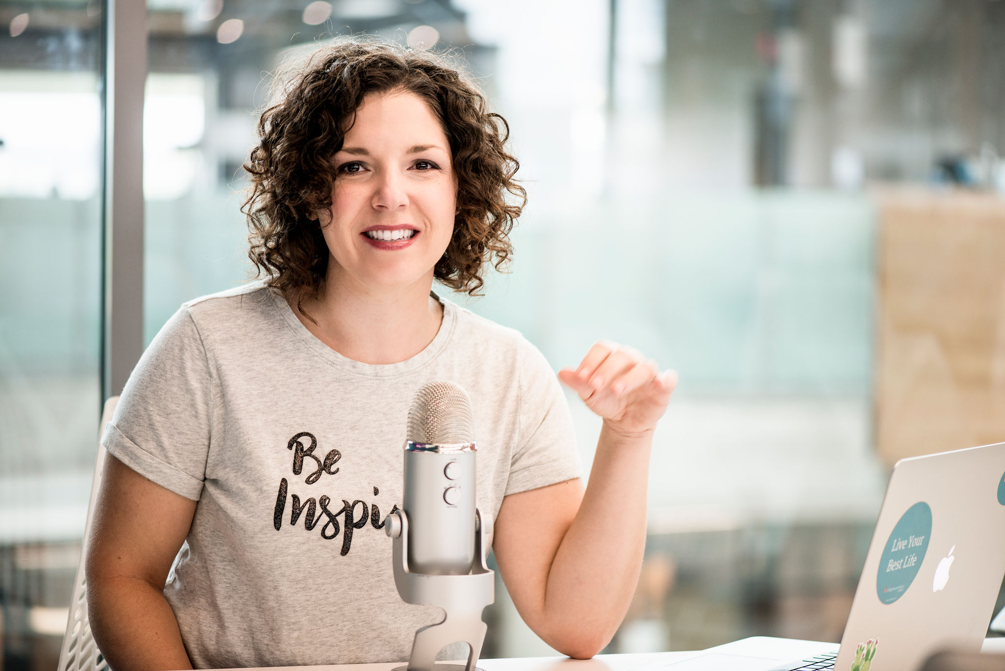 Image of host of the Collegehood Advice Podcast, Katy Oliveira, recording an episode.