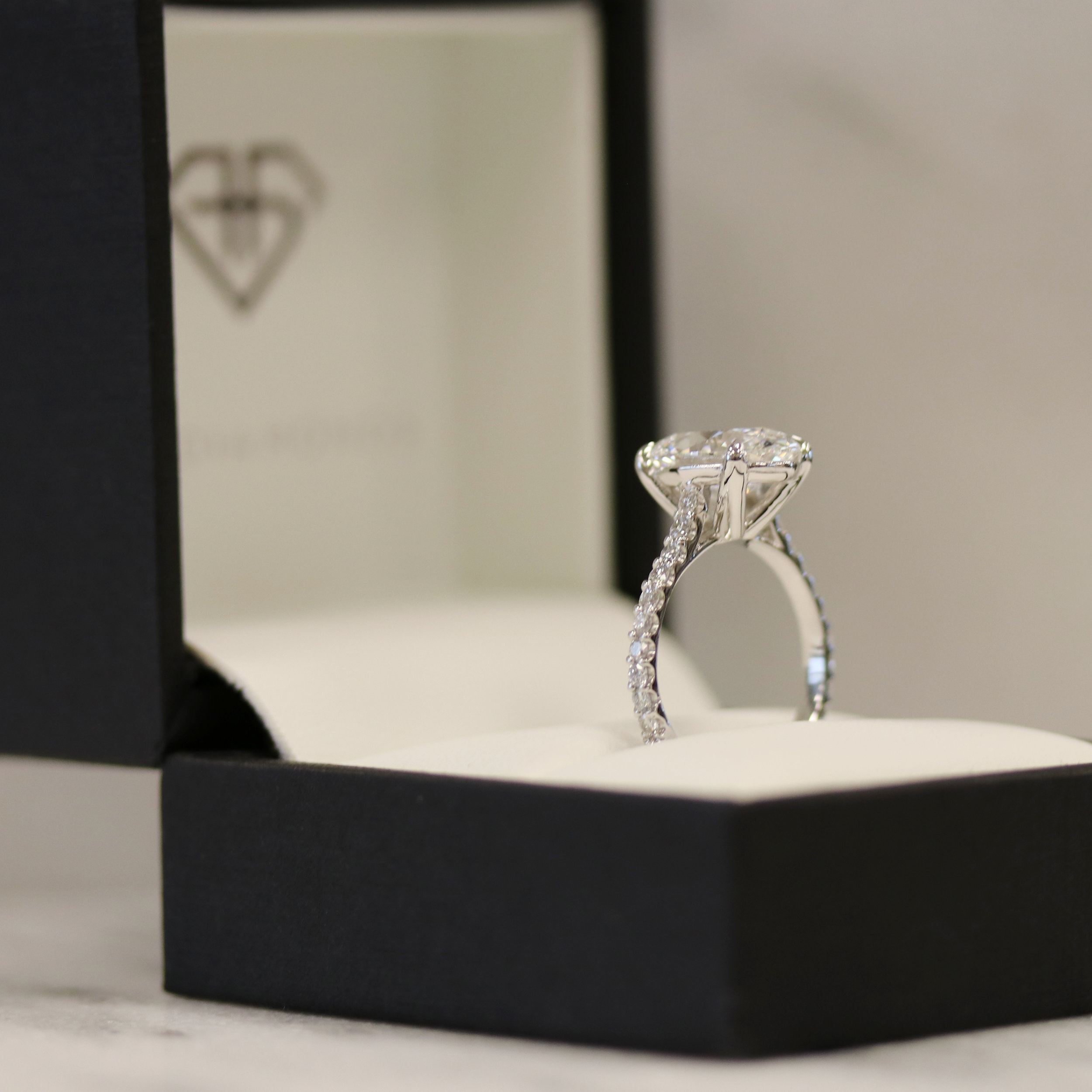 3 carat lab grown oval diamond engagement ring with diamond band setting