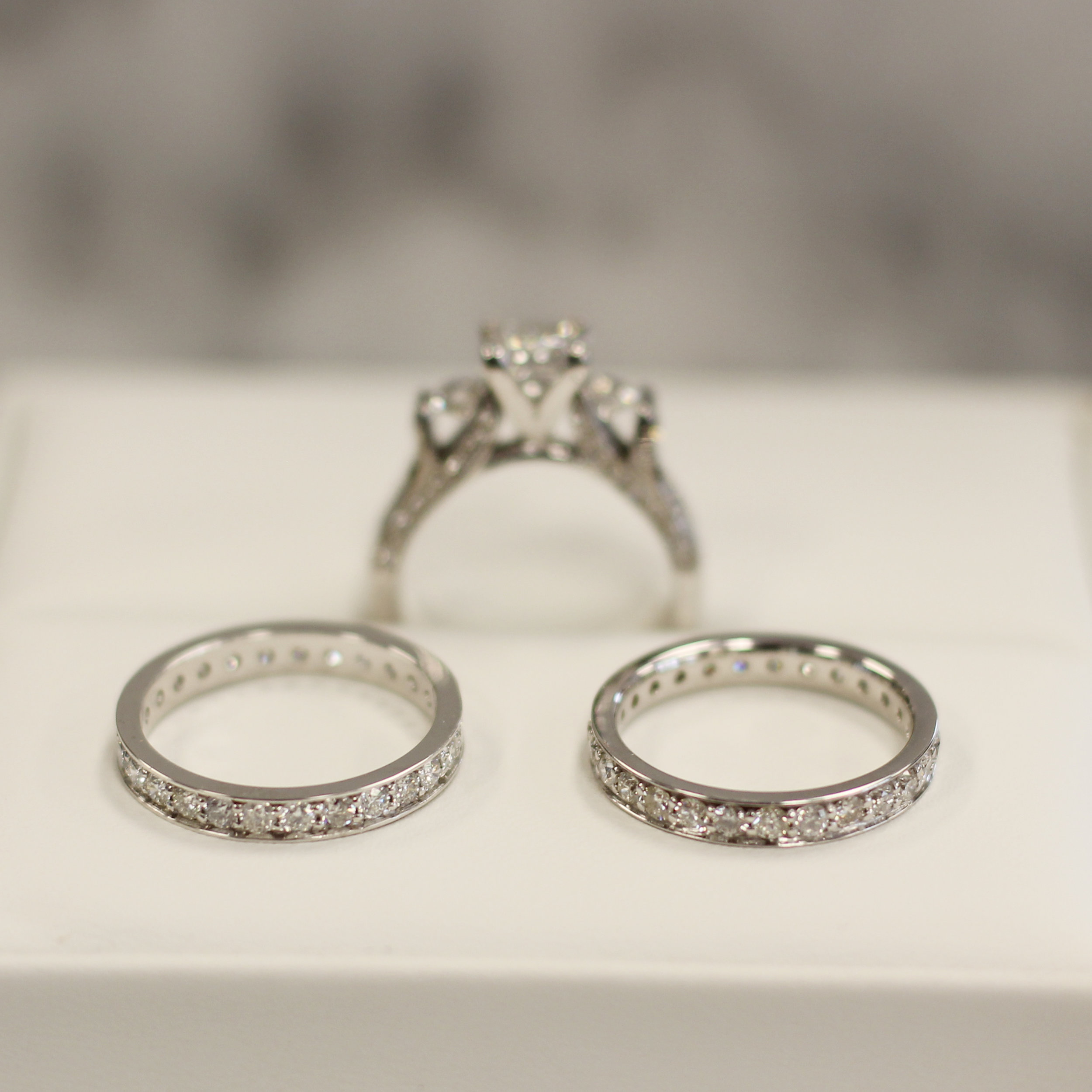 lab grown diamond three stone diamond band engagement ring with channel set eternity wedding and anniversary band