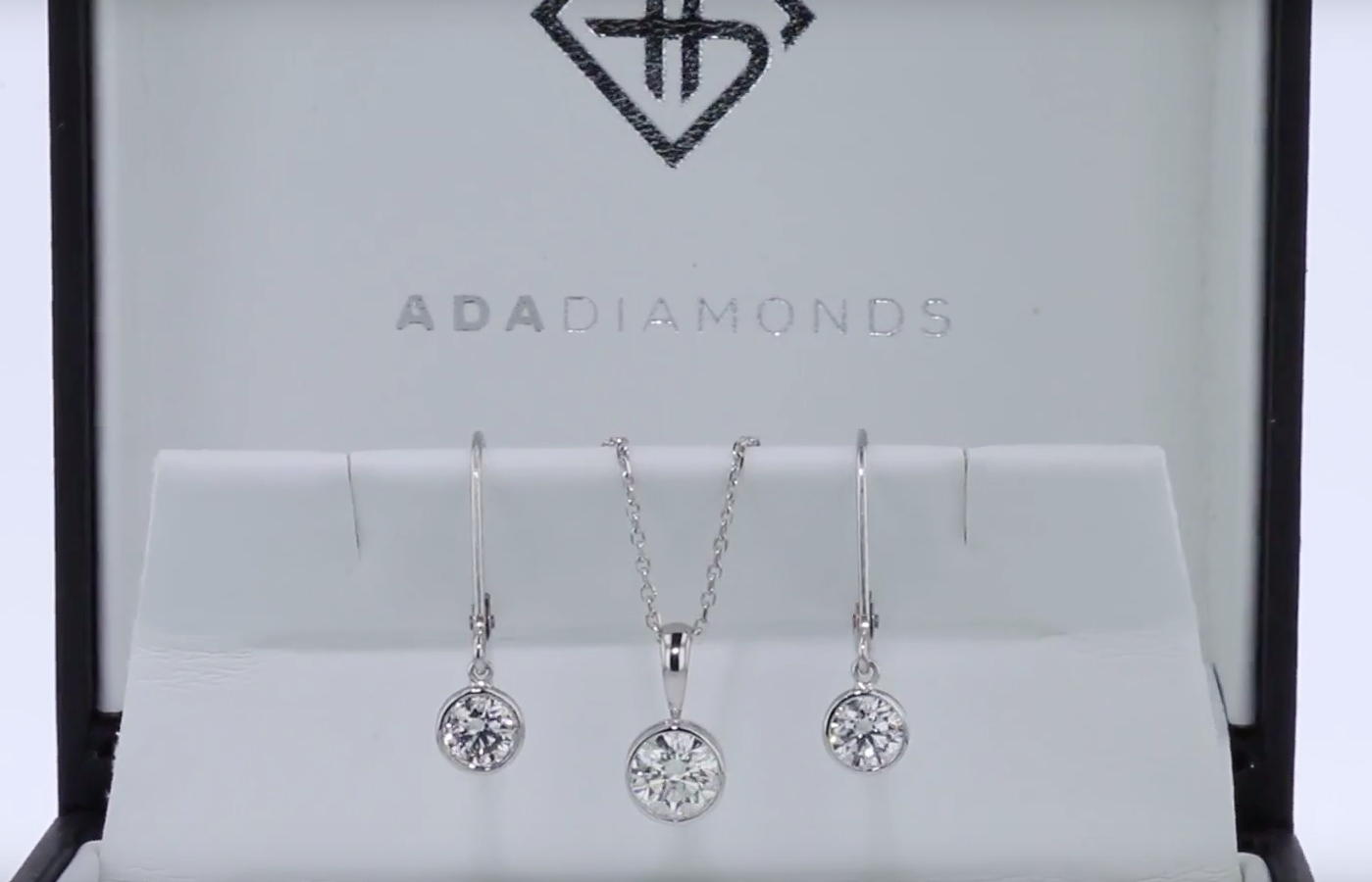 matching set of lab grown diamond earrings necklace bezel set in white gold