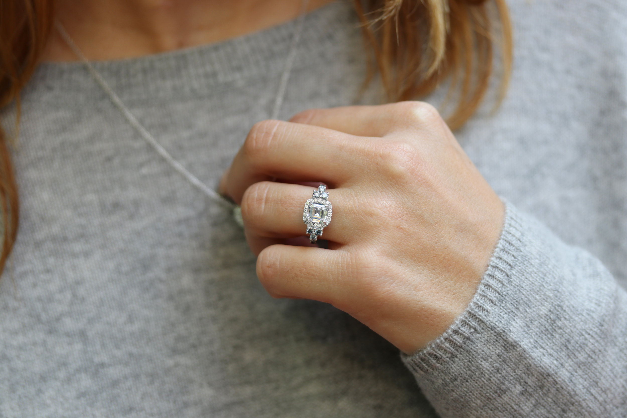 custom lab diamond engagement ring with asscher diamond center stone and fancy blue diamond halo and hidden gallery