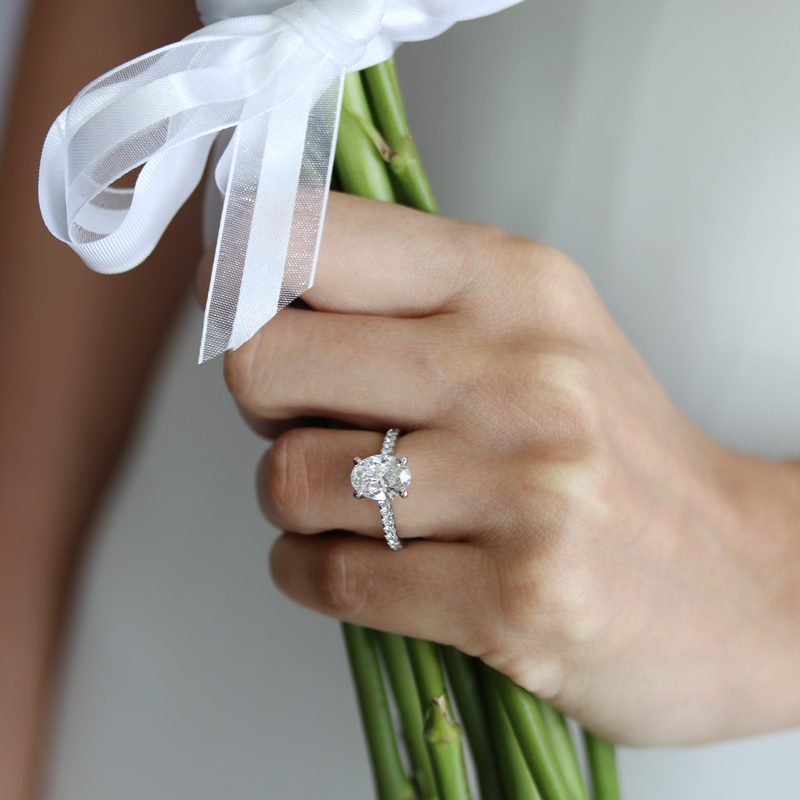lab grown oval diamond engagement ring with diamond band