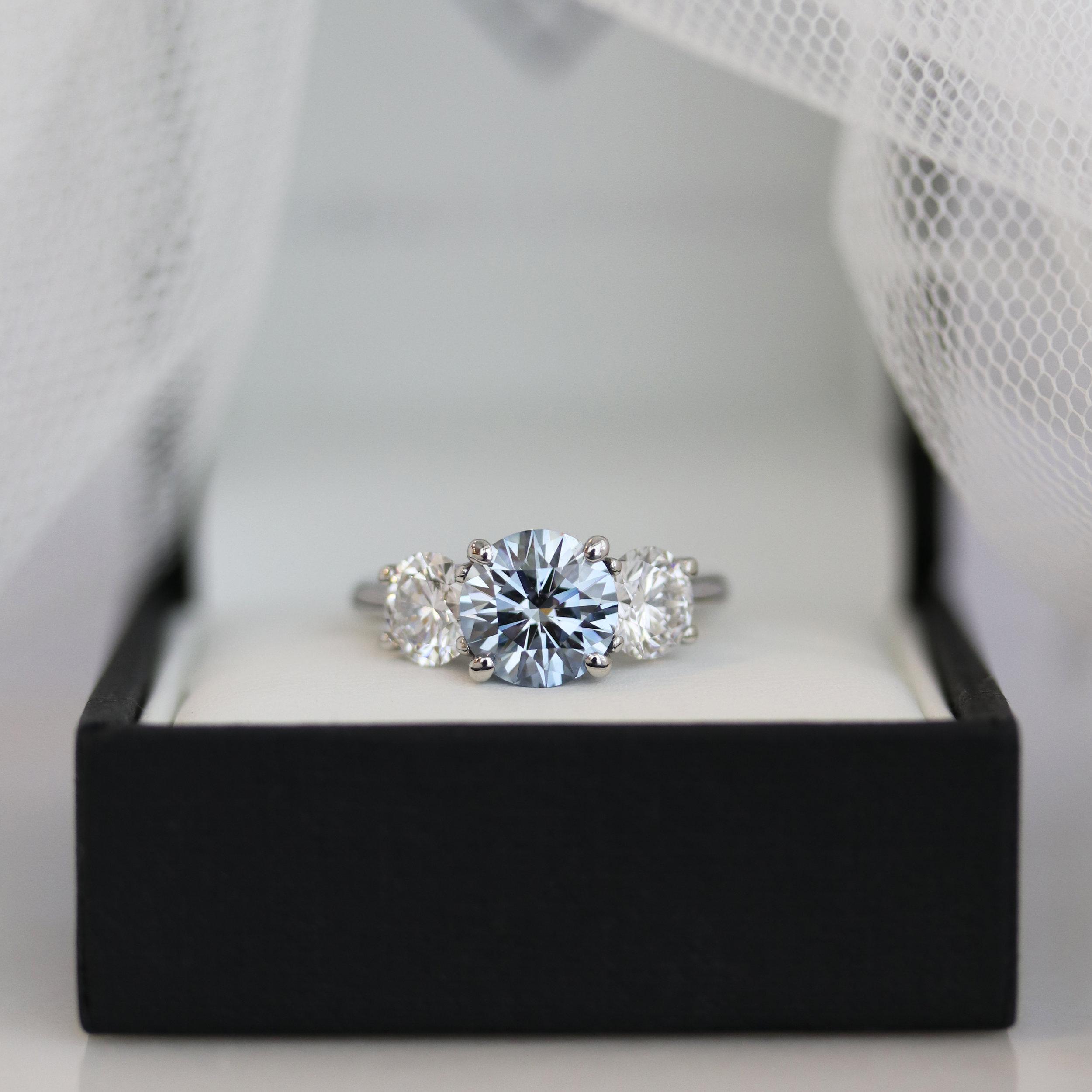 Three Stone Ring with blue diamond center