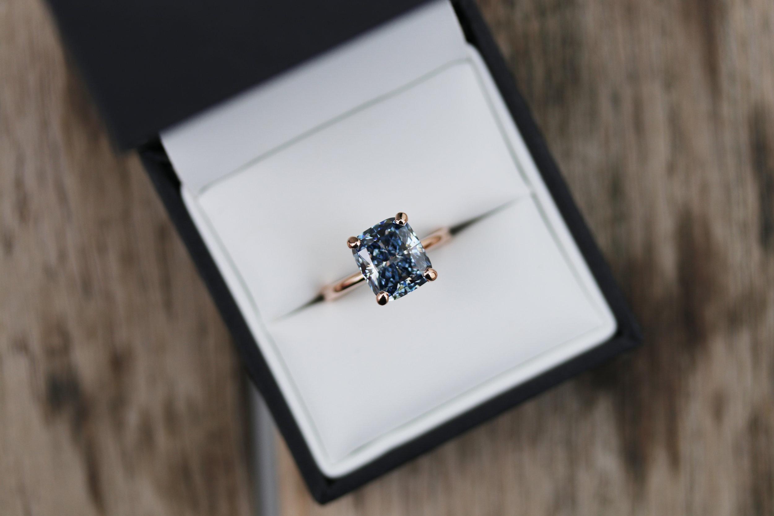 fancy blue cushion cut lab diamond engagement ring set in rose gold