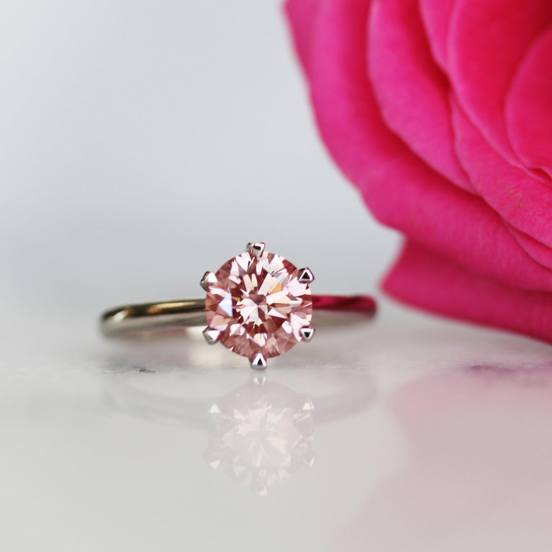 Ada Diamonds six prong solitaire lab diamond engagement ring with fancy pink lab diamond