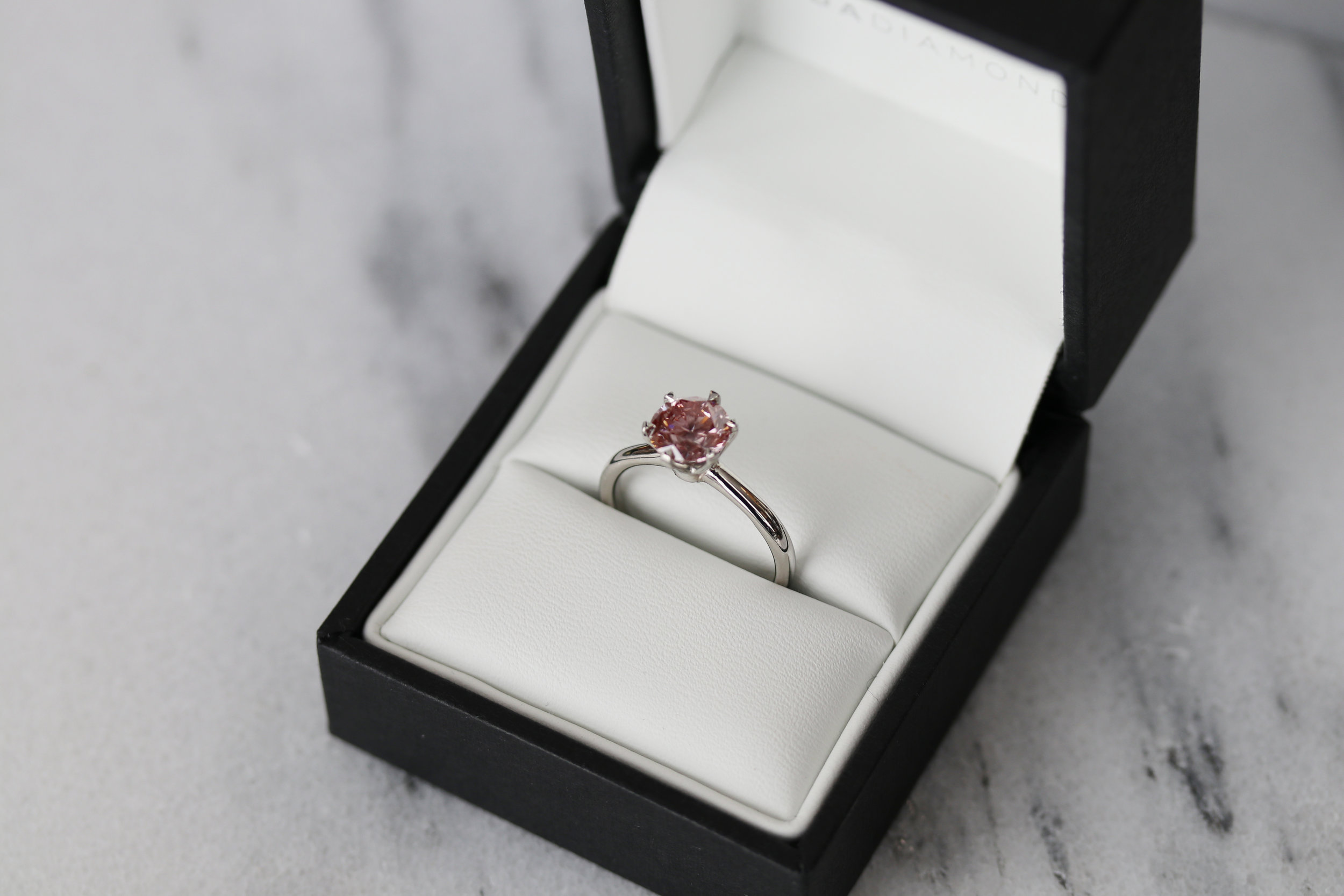 Fancy pink lab diamond six prong solitaire engagement ring in platinum