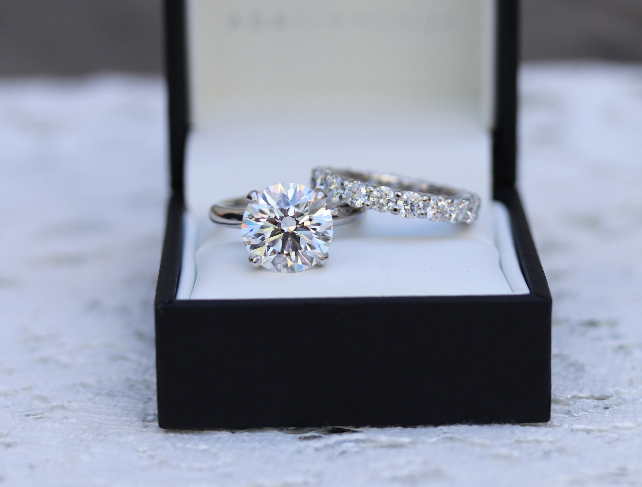 Classic four prong lab diamond solitaire engagement ring in platinum with prong set lab diamond eternity band