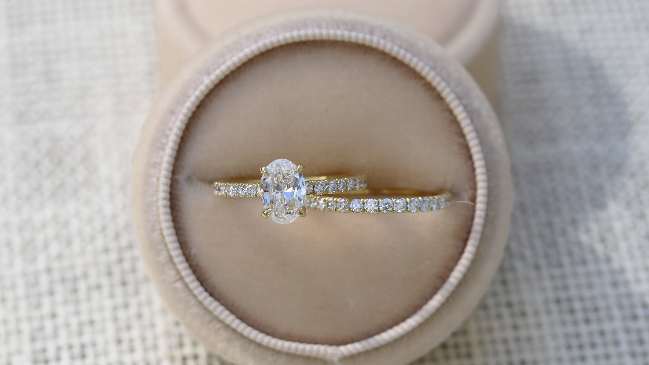 Oval cut lab diamond engagement ring in yellow gold with lab diamond eternity band