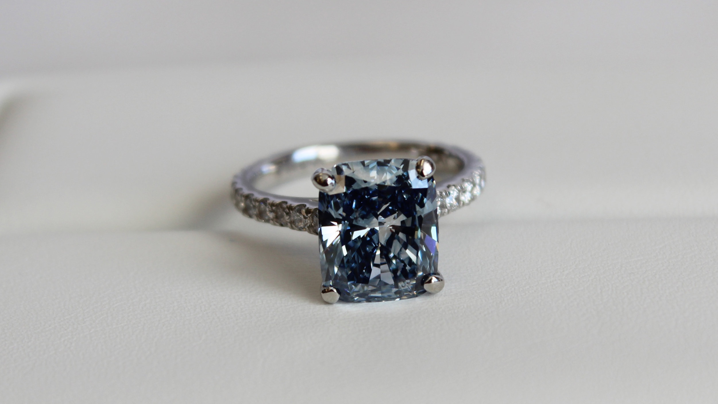 blue cushion cut lab grown diamond pavé engagement ring