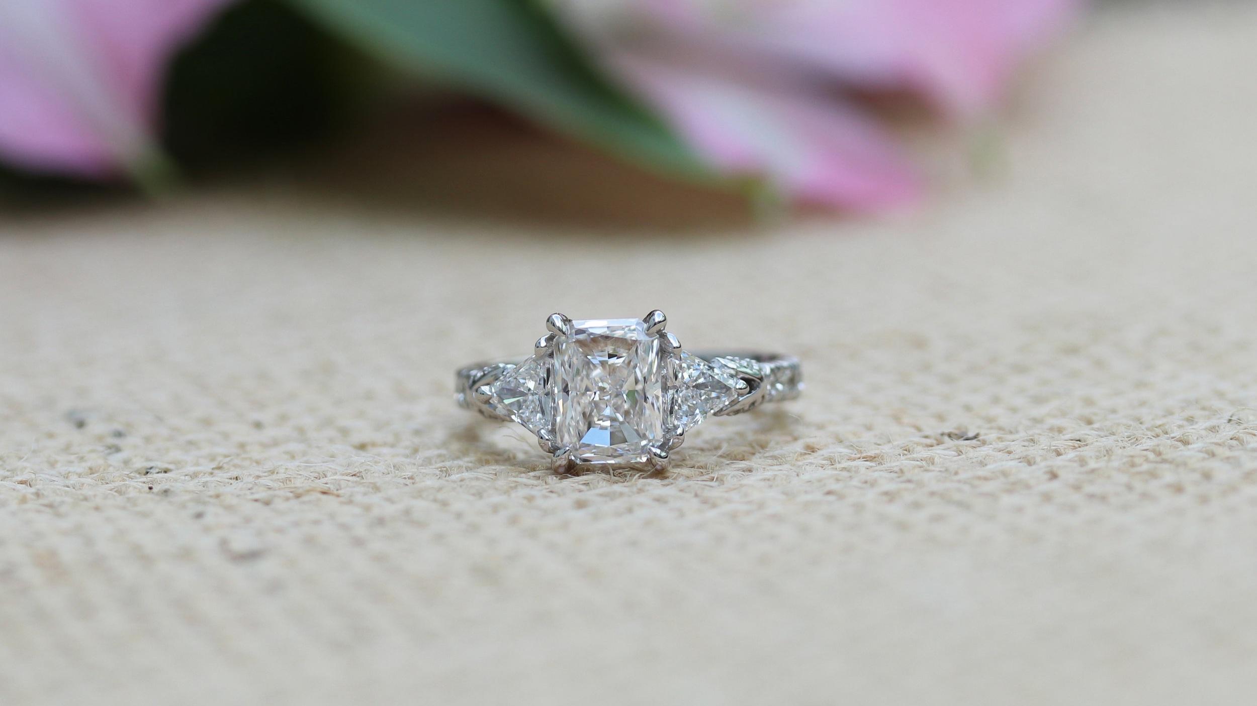 three stone radiant lab diamond engagement ring with trillion side stones