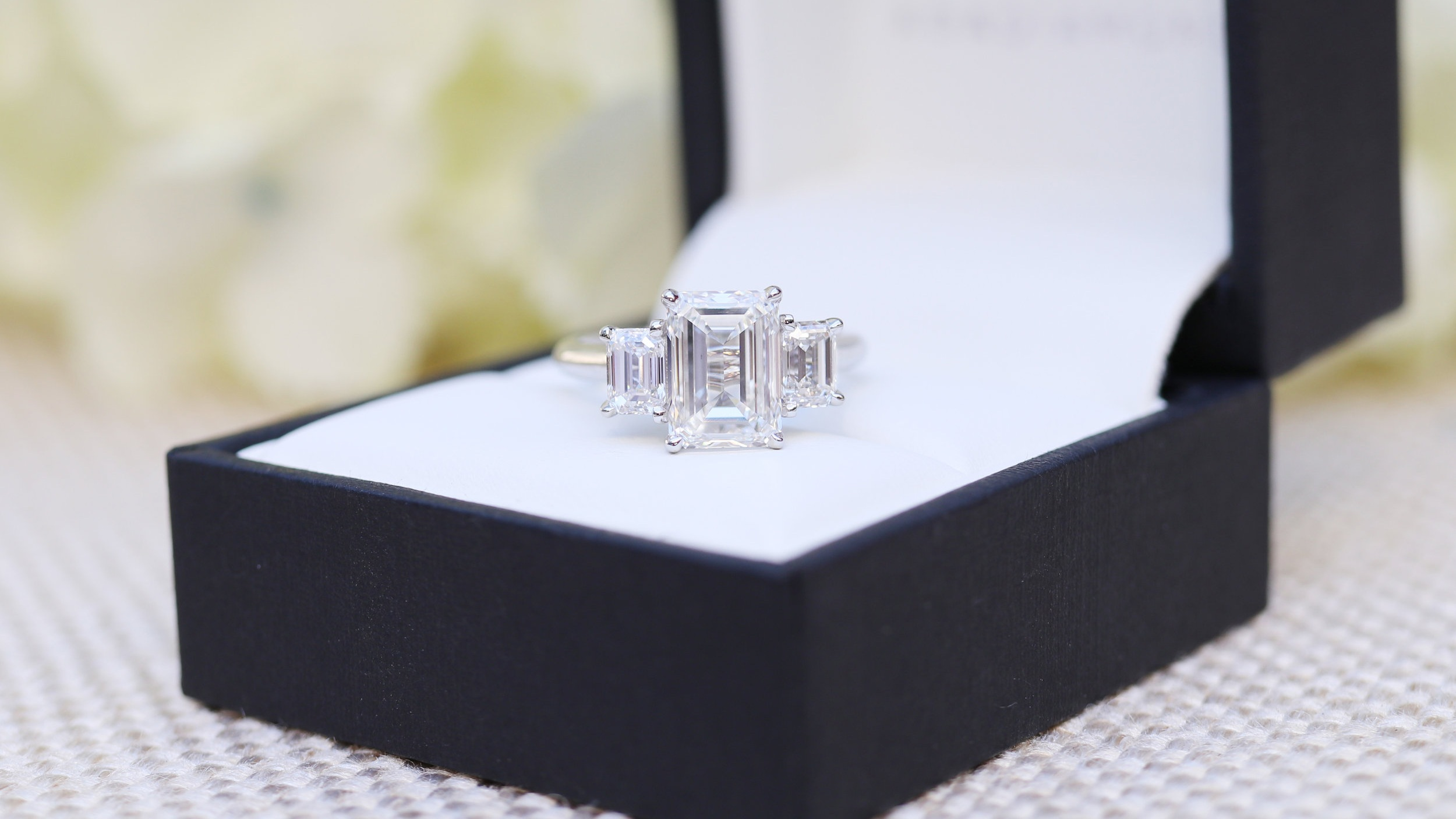 emerald cut three stone lab diamond engagement ring ad-114