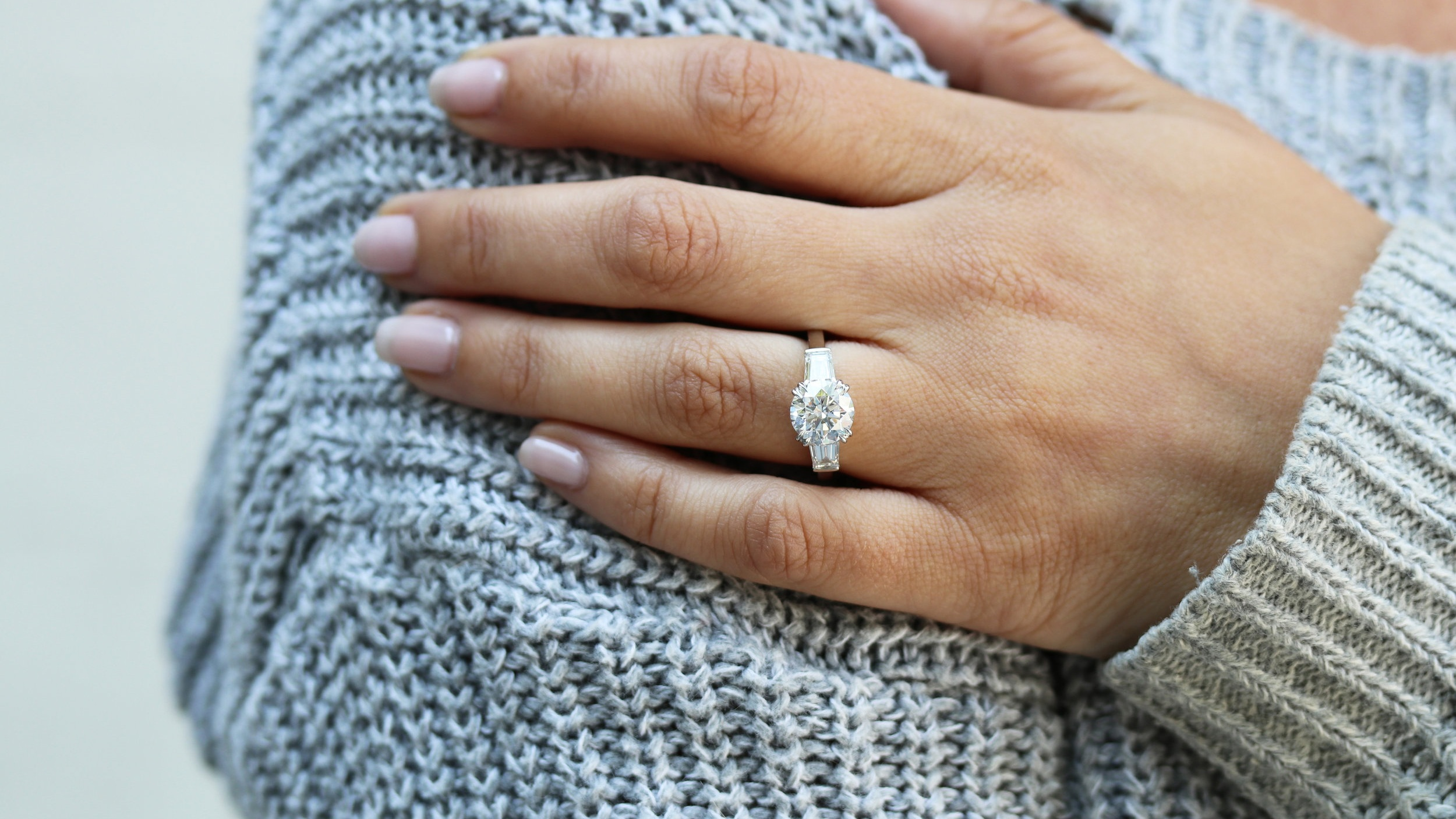 three stone round and baguette lab created diamond engagement ring