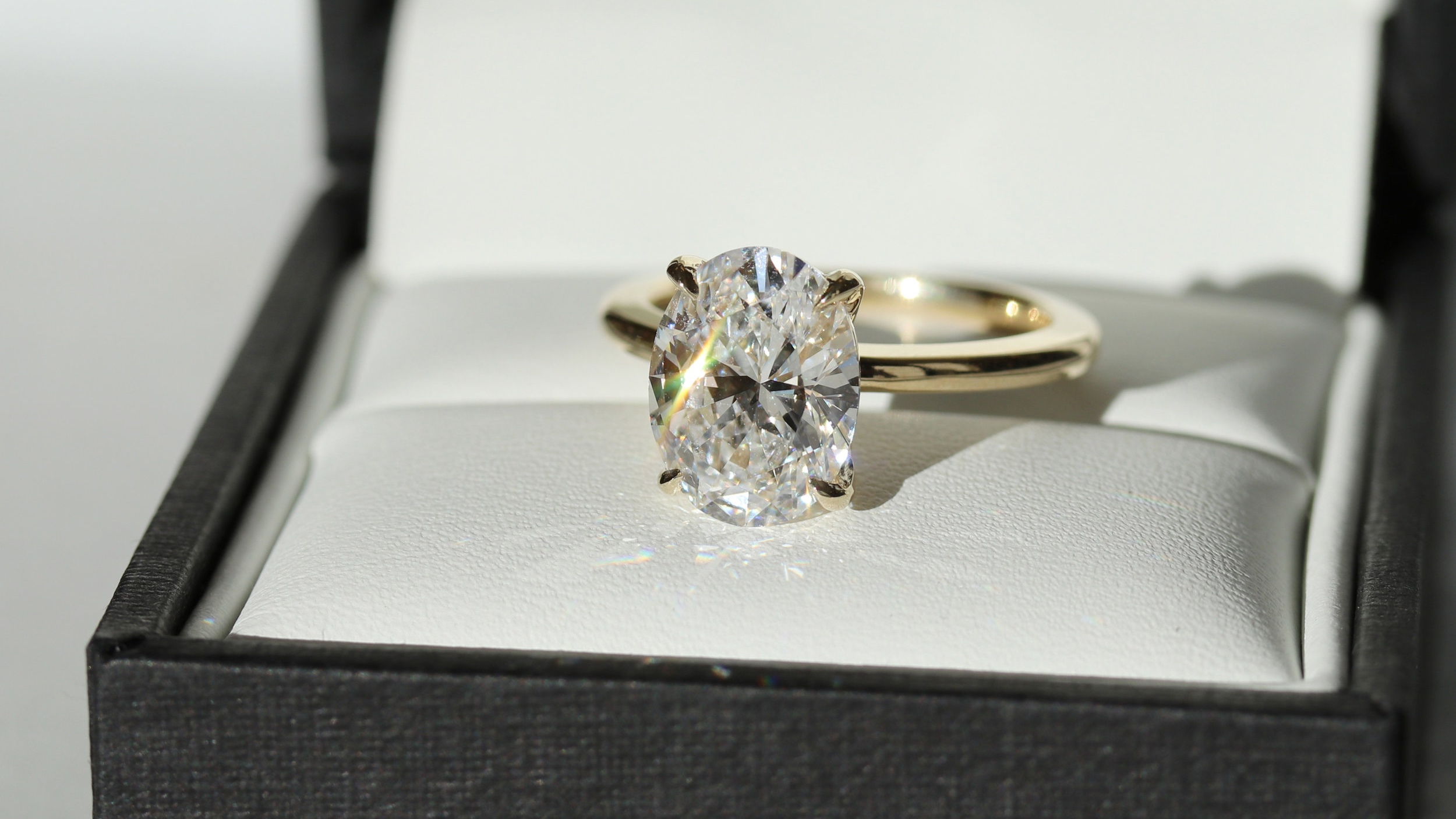 Finished Four Prong Solitaire featuring a 2.51ct Oval Lab Diamond