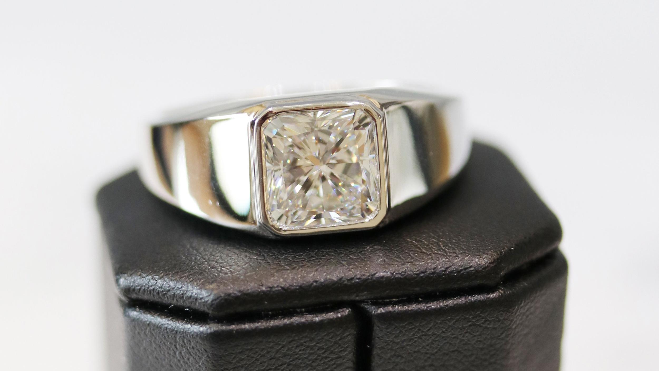 Men's Bezel Set Ring in Platinum Featuring a 4.37ct Radiant Cut center stone.