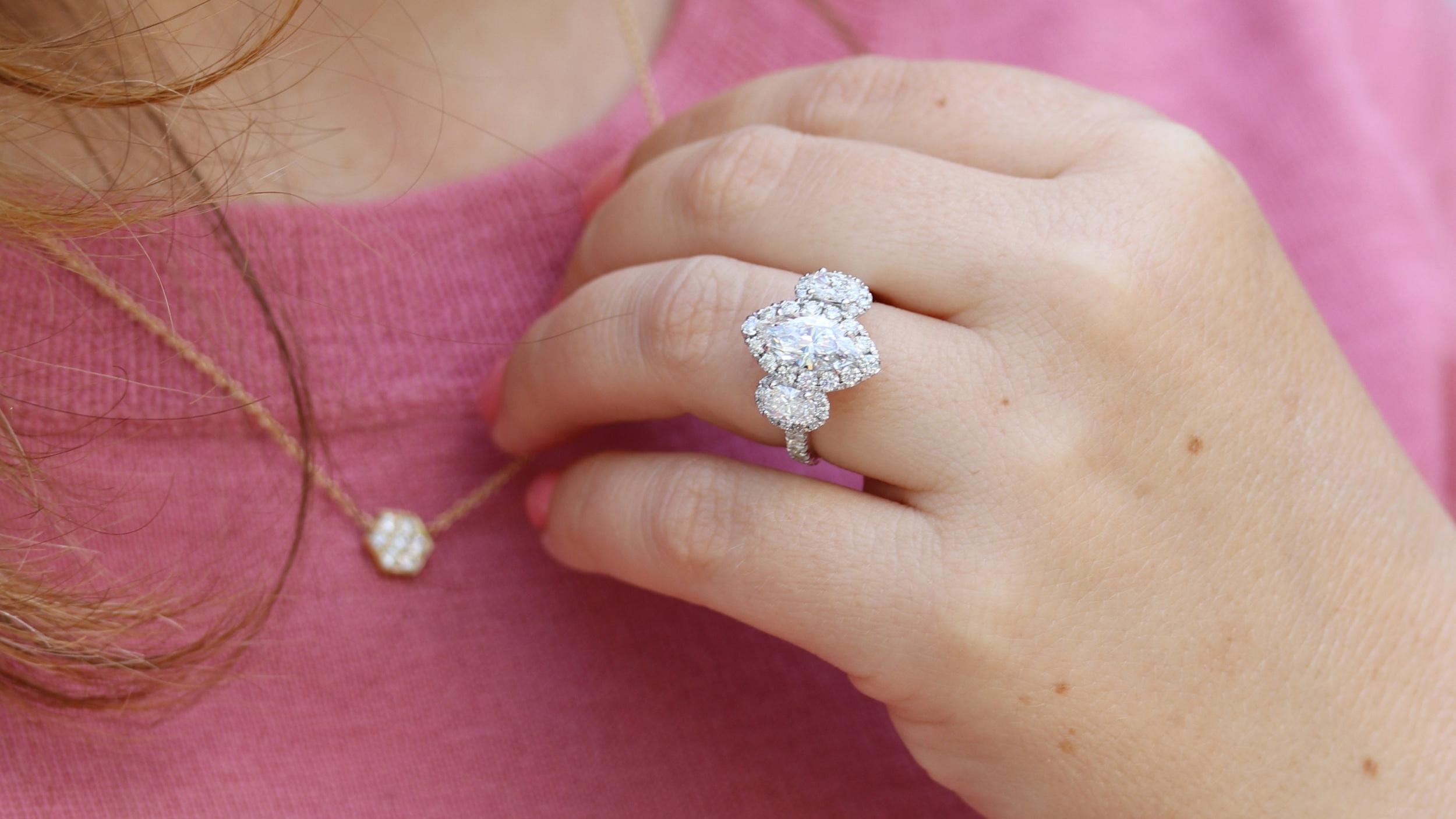 two carat cushion cut lab diamond halo engagement ring and lab diamond eternity band