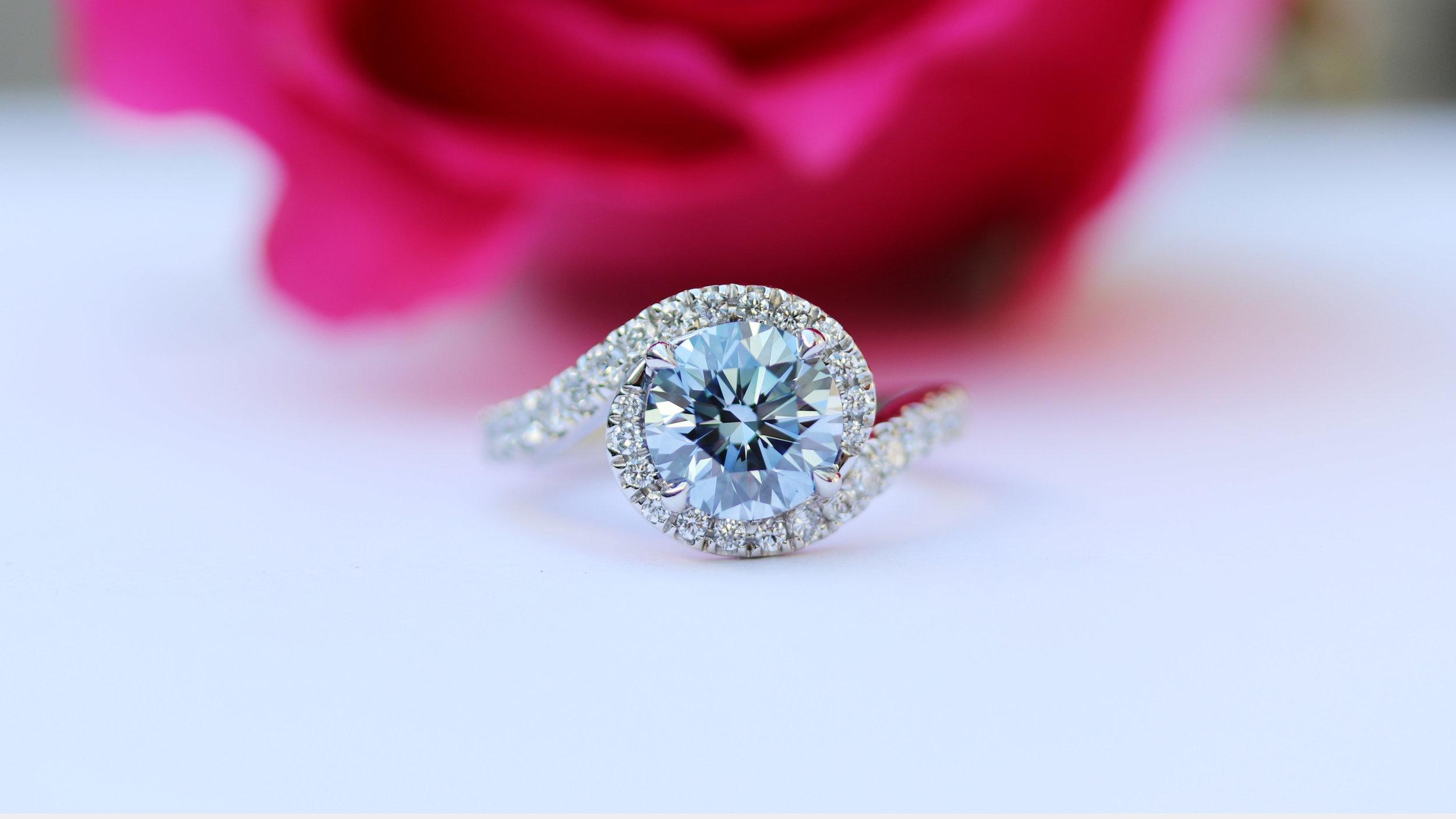 Fancy blue halo diamond engagement ring