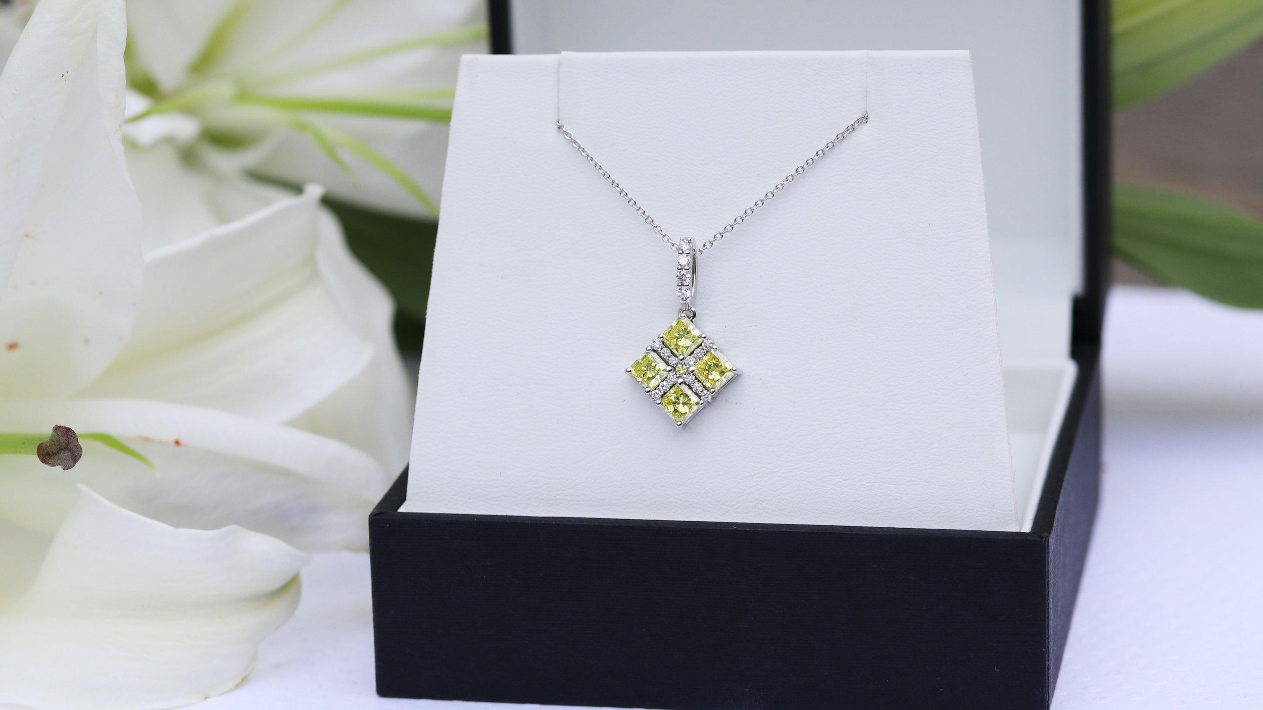 Fancy Pink lab grown diamond stud earrings with colorless diamond halo