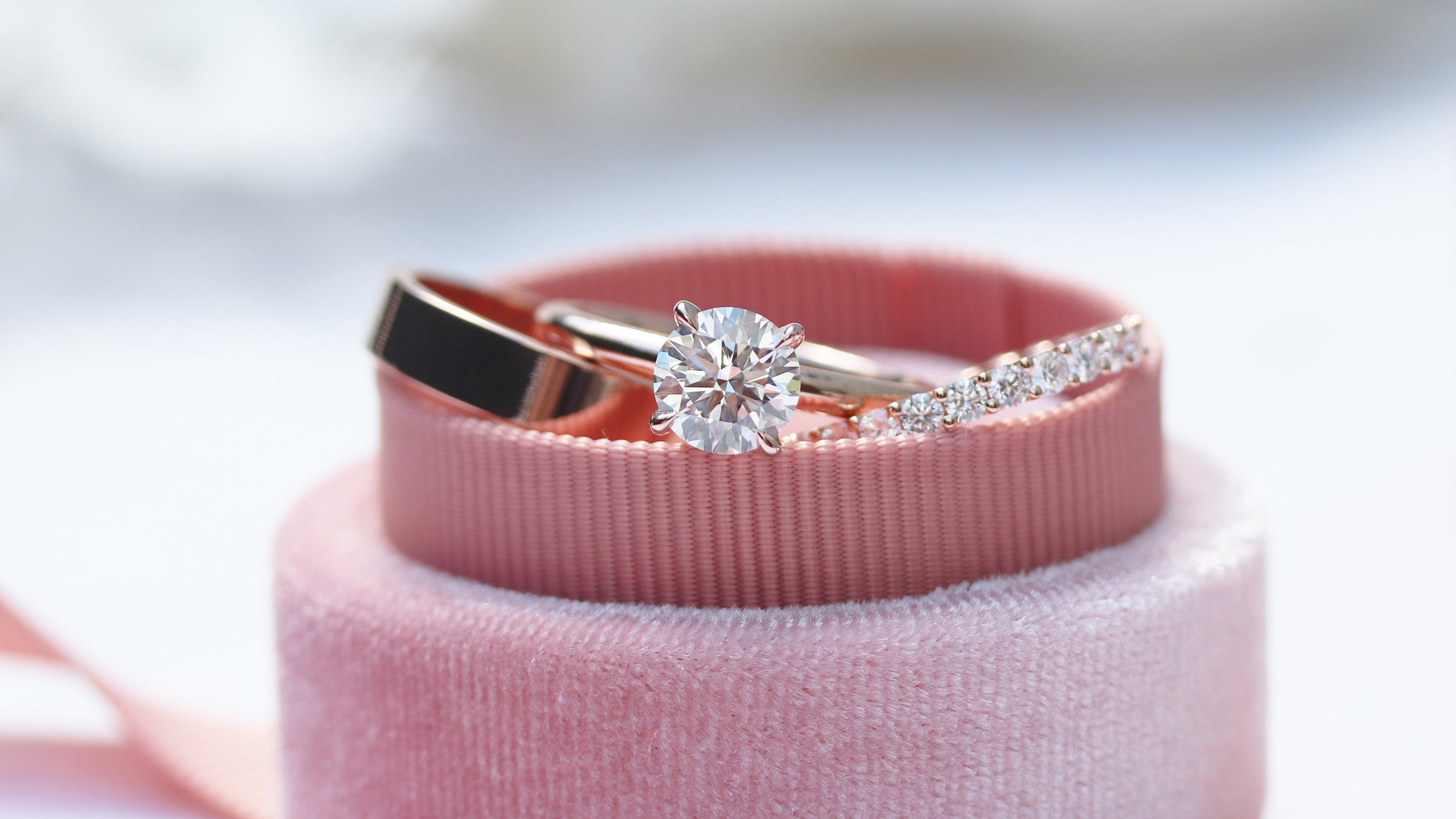 Round brilliant lab diamond engagement ring in rose gold with matching rose gold channel set lab diamond eternity band