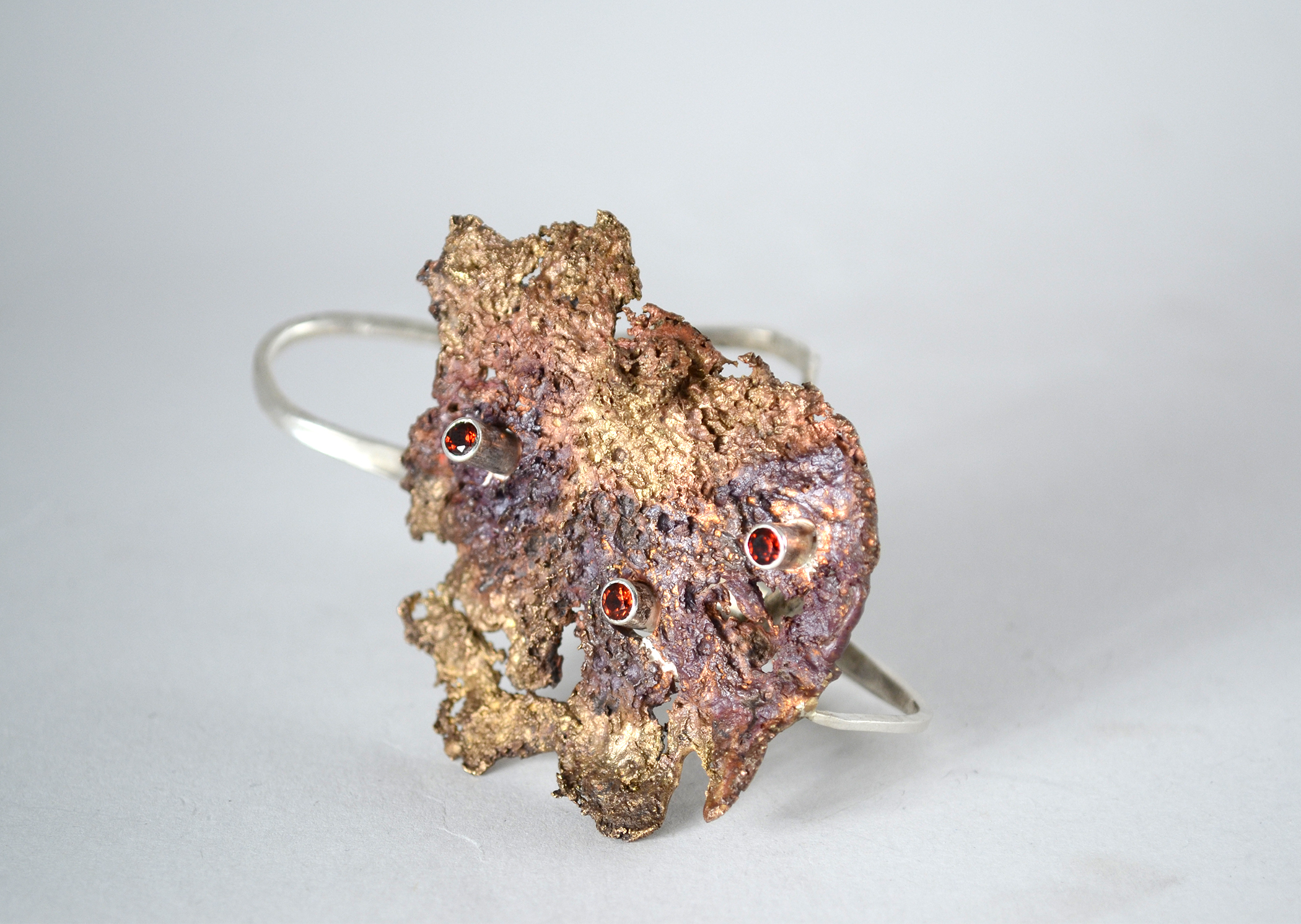 decompose | decaying mushroom cast in bronze, sterling silver, tube set garnets