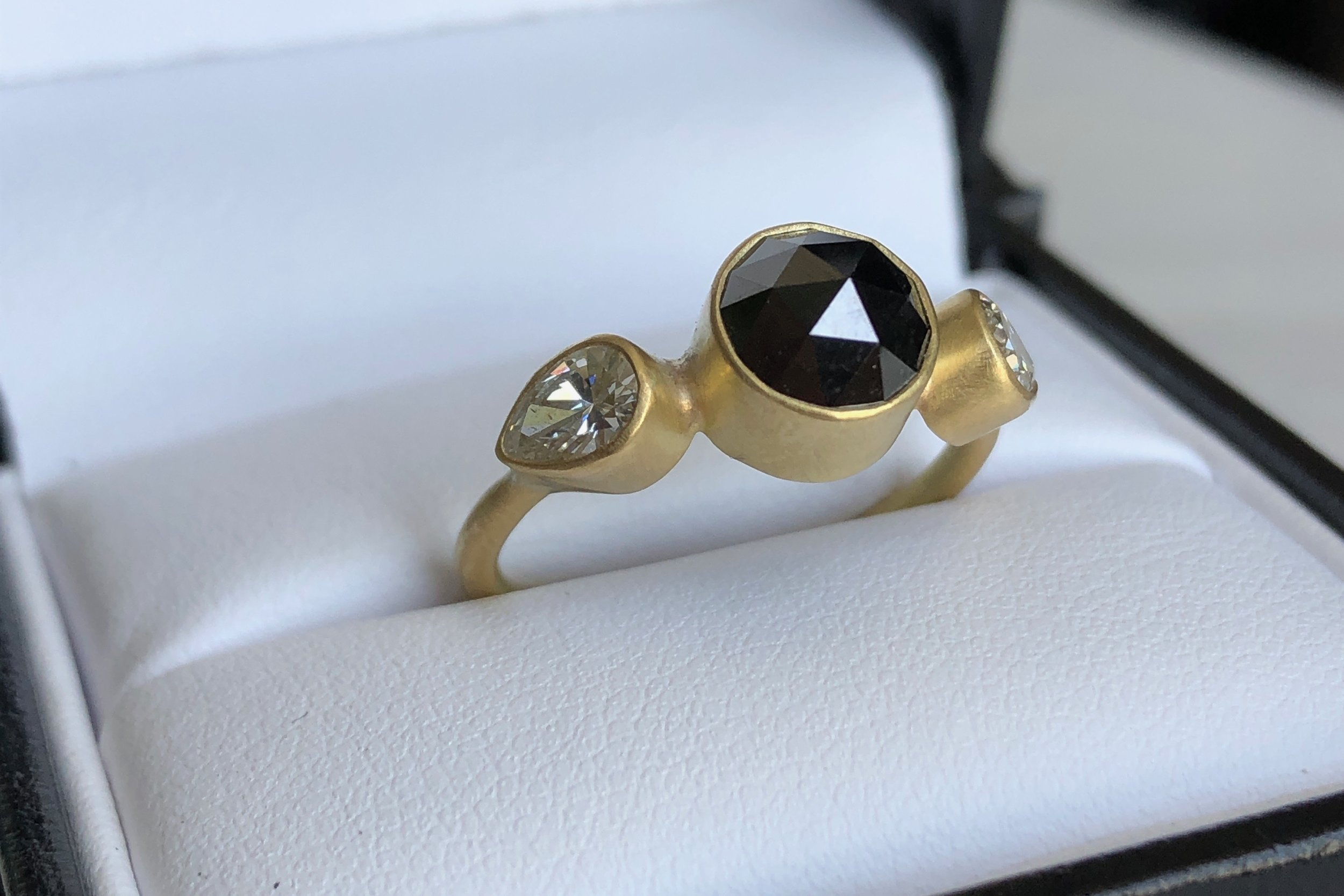 engagement ring | rose cut black diamond, pear white diamonds, 18k gold