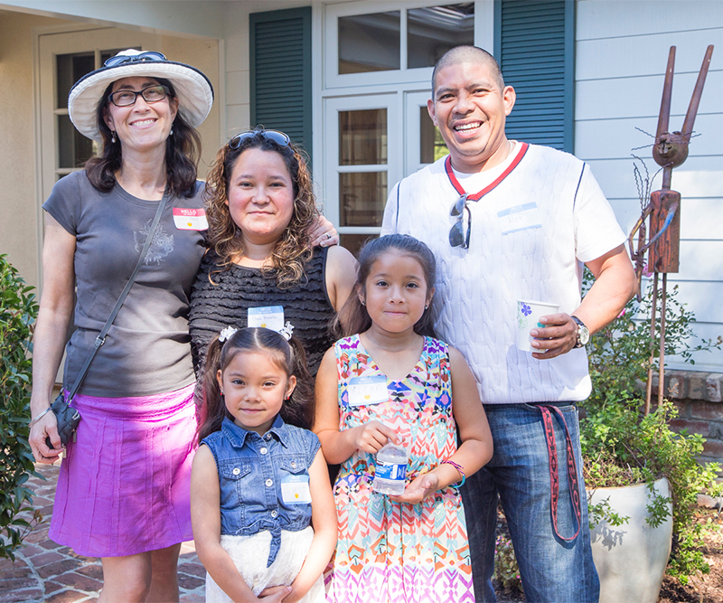SASS tutor Erika Pretell  (left), and Erika's student, Diana Viscarra, with Diana's family, at the picnic.