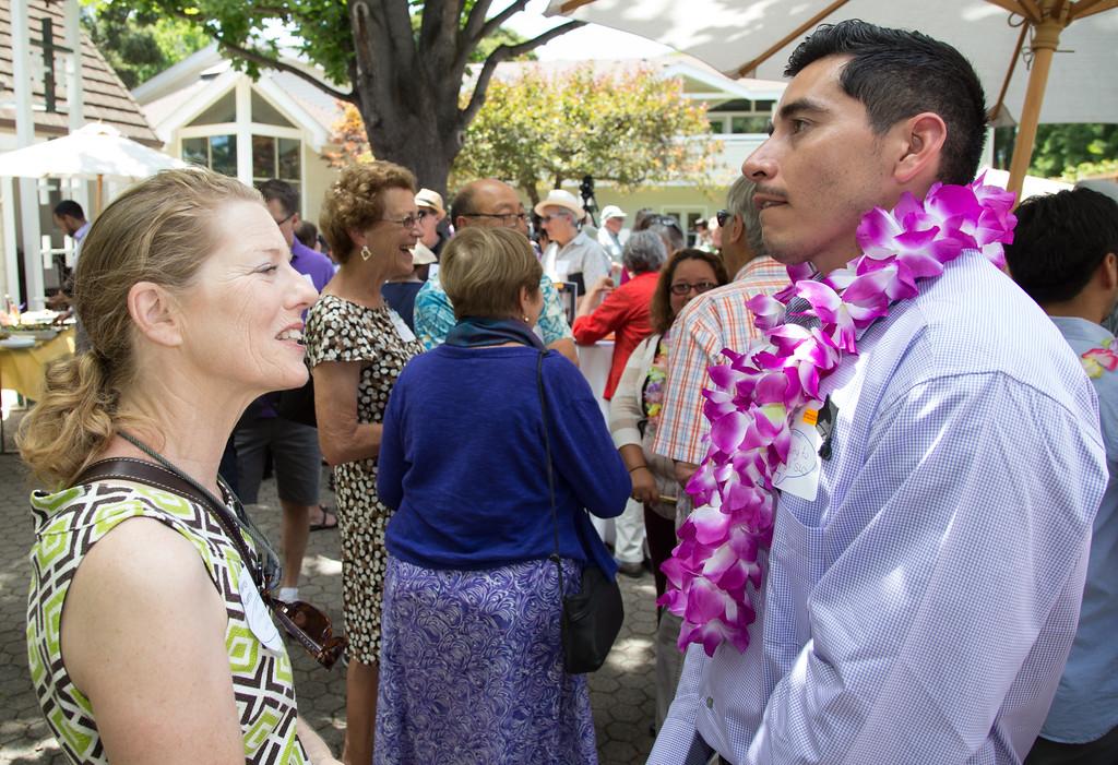 SASS Board Member Wendy Kuehnl Ortiz chats with SASS recipient Amado Flores.