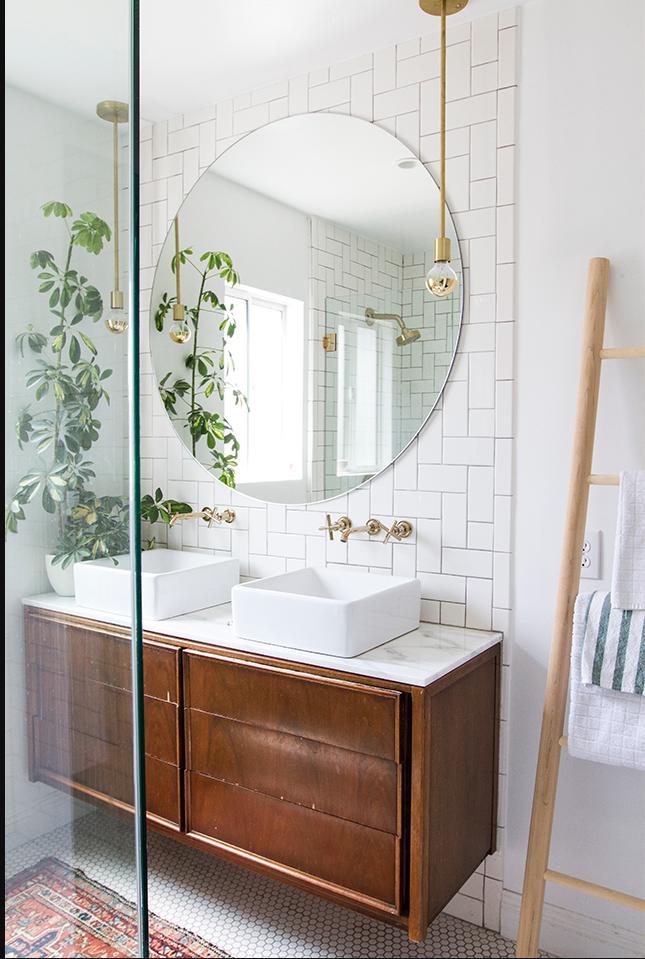 I love how  Sarah Sherman Samuel  laid her subway tile in her bathroom. It reminds me of a geometric version of herringbone.