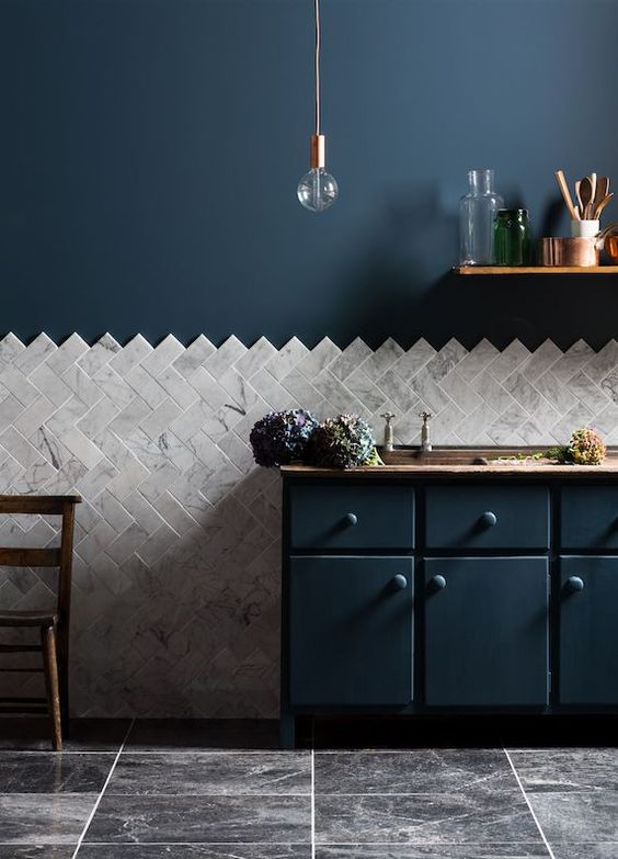 I love the exposed edge on this diagonal herringbone design. I did something similar with hexagon tile in my  bathroom . It adds that extra element of surprise, which I relish. Image Via  Food52