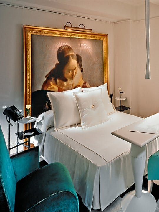 Ian Schrager used a large vintage piece of art in each bedroom of  New York's Paramount .  Image via  apartment therapy