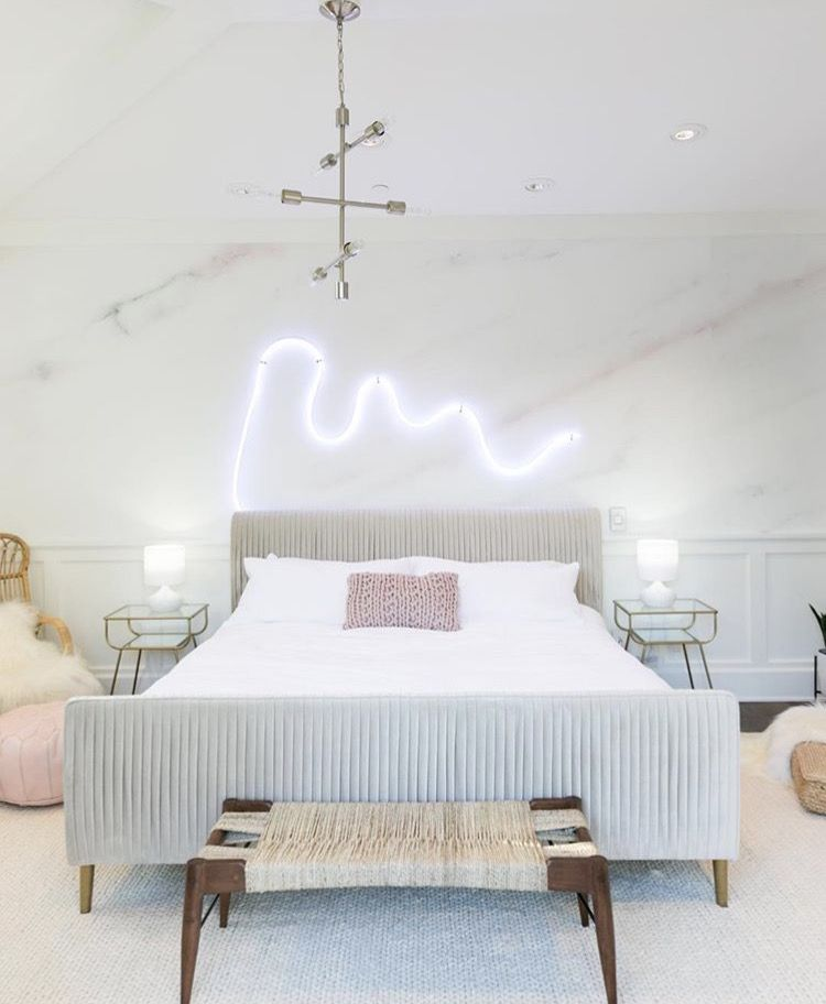 I'm really into this abstract neon light that kind of looks like an ocean wave to me. More photos of this Palm Springs bedroom makeover  here .