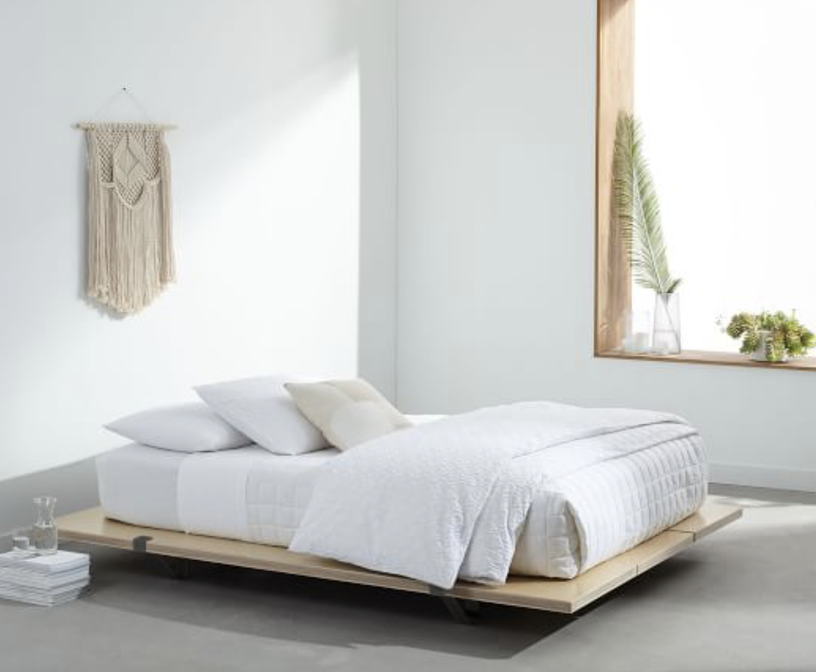 The Floyd Platform bed from West Elm, doesn't have a headboard, but it has that ultra zen vibe about it, and would look cool in any room! Prices start at $495 for a twin.