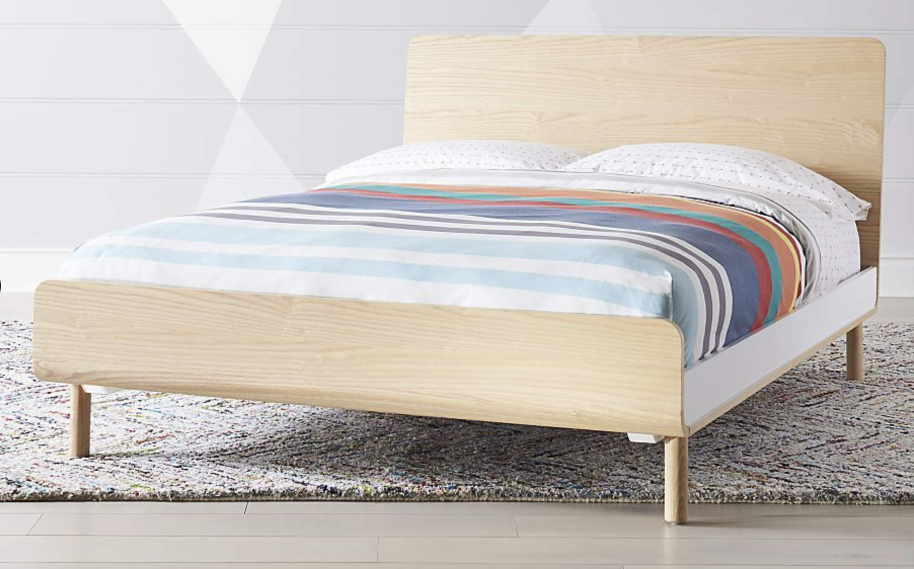 Paxson's Bed by Crate and Barrel is super cute, and versatile. It would be a great teenager bed as well, at only $799 for a full.
