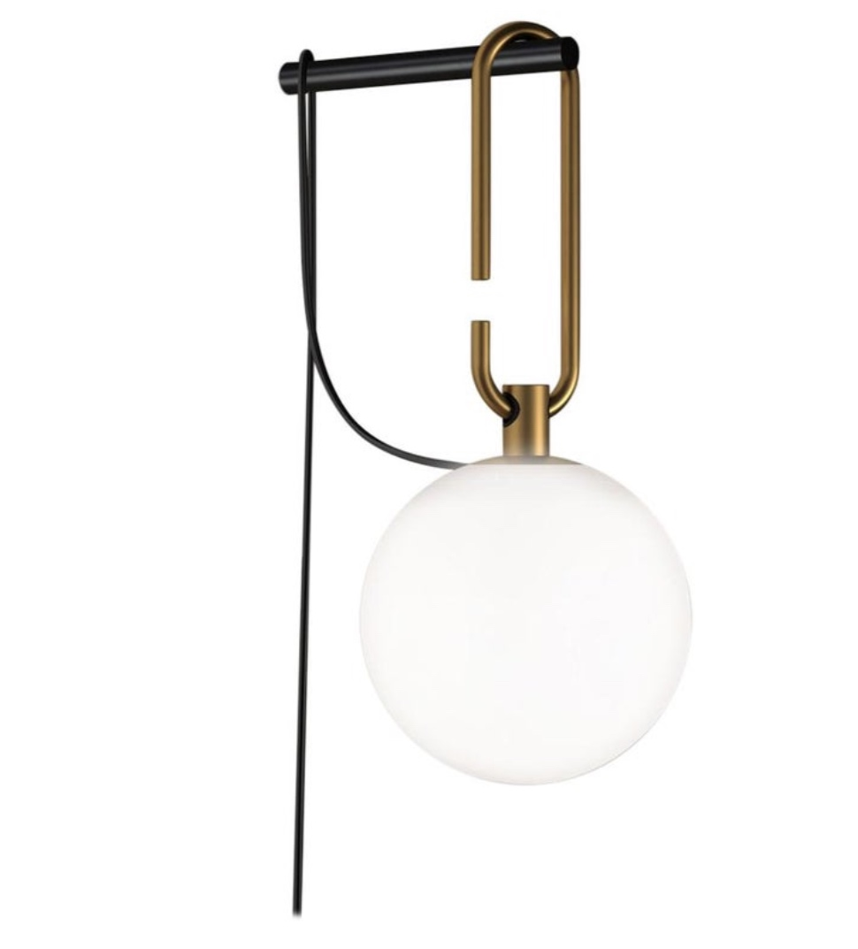 This sconce caught my eye, and at $340 a pop, it doesn't completely break the bank.