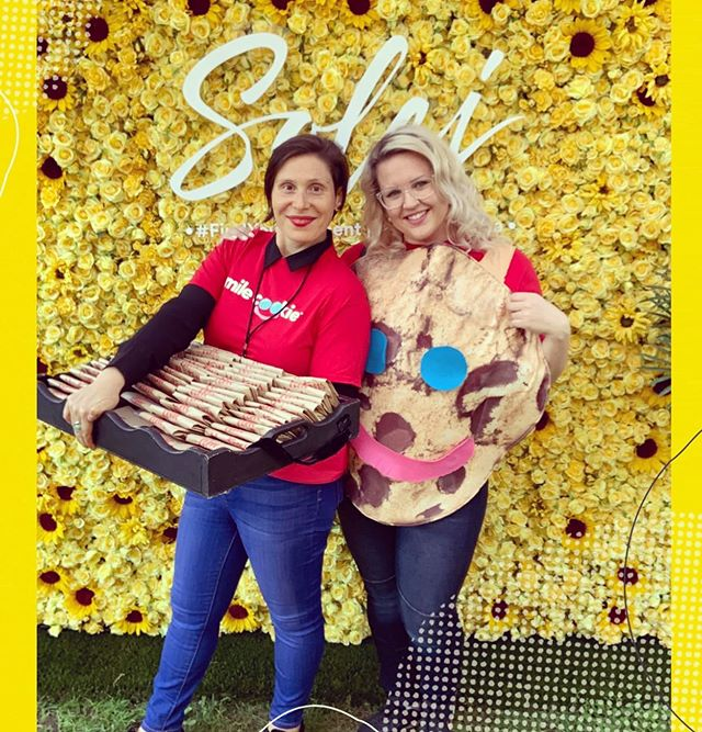"Introducing your dynamic duo, ""The Cookie Girls"". 🌻 🍪  @kferraro85 and I sold over 300 $1  @Tim Horton 😊 SMILE COOKIES 😊 to our @cityfolkfest friends at #ottawa 's Landsdowne Park. 🍪 🌻  All proceeds went to the Ottawa @the_snowsuit_fund that gives thousands of snowsuits to children in need across the Ottawa Area. 🍪  Get your #smilecookies @timhortons from September 16-22, 2019 or donate clothing at the drop off depot at: 225 Donald Street Unit 134 in Ottawa. 🌻  Help support a great cause in a sweet way 😋 🍪 and help keep a child stay warm this winter. 🙏 ❤️ Thanks to our friends @soleicanada for the flowery backdrop 🌻 🌸  #cookiegirls #cityfolkfest #ottawa #ottawamusic #ottawafestivals #getyourcookies #timhortons #snowsuitfund #smilecookies #findyourmoment"