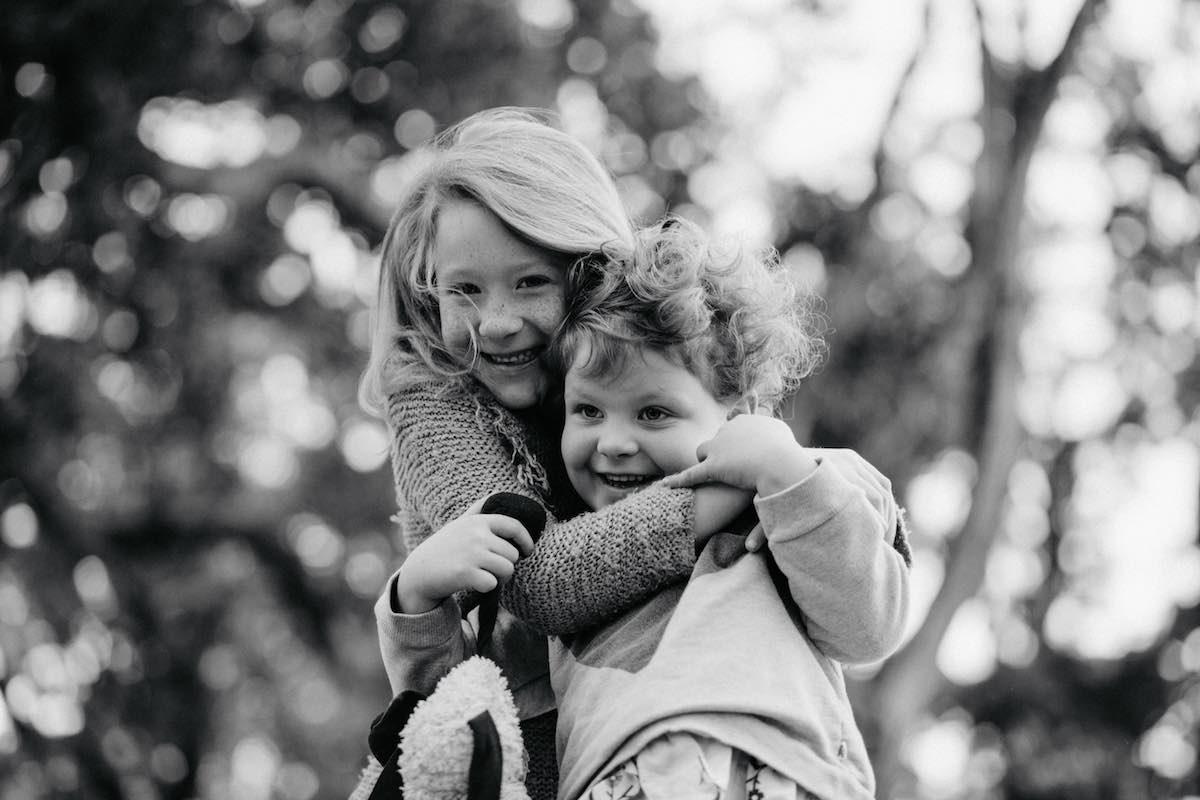 Black and white children at family photo session.jpg