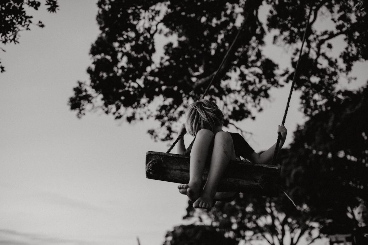 Photograph of boy on swing - Emily Chalk.jpg