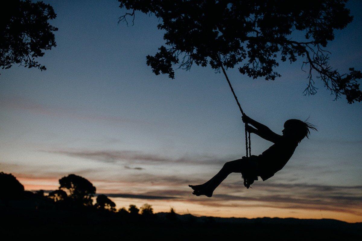 Photograph of child on swing at sunset - Emily Chalk.jpg