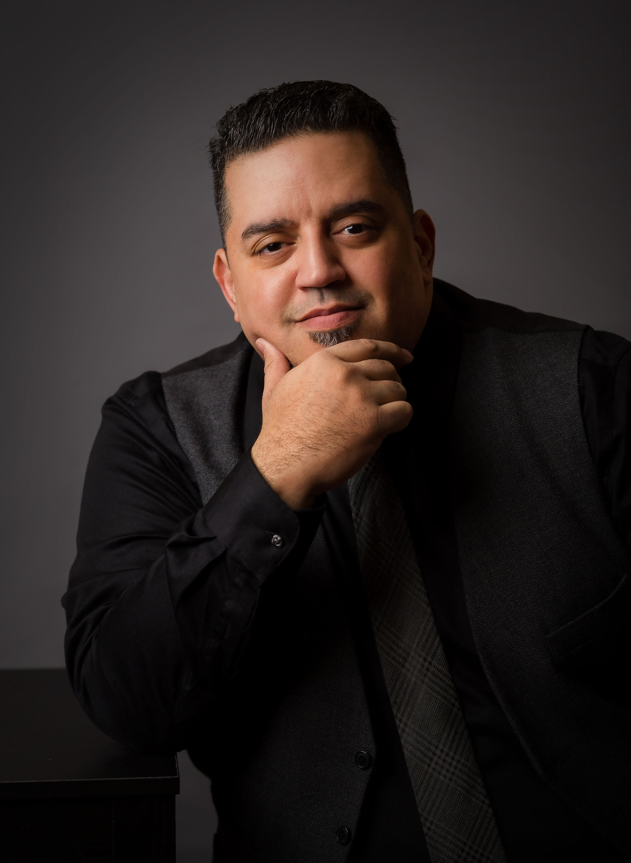 Alex Garcia - Raised in Allentown, PA, Alex brings passion and experience as an artist to the creation of beautiful images for both weddings and quinceañeras.