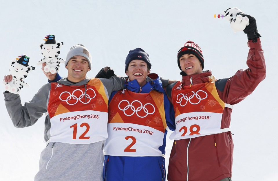 Academy Alumni Nick Goepper (left, silver medal) and Alex Beaulieu-Marchand (right, bronze) stand on the Olympic podium for Men's Slopestyle Skiing.